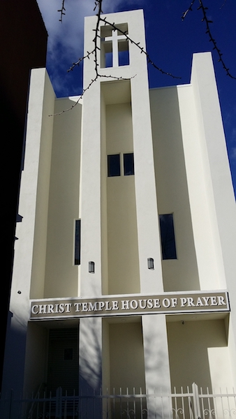 Exterior view of Christ Temple House of Prayer after completed construction with beige tower