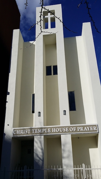 Exterior view of Christ Temple House of Prayer after completed construction with cross on top