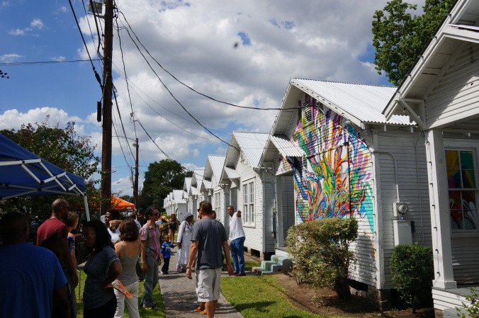 Project Row Houses is an art project integrated into the underserved African-American community of the 3rd ward in Houston, TX. PRH offers public arts programming, resource directories, a single mom's program, collaborates with Rice Universities Architecture program, and more. Find out more:http://projectrowhouses.org.