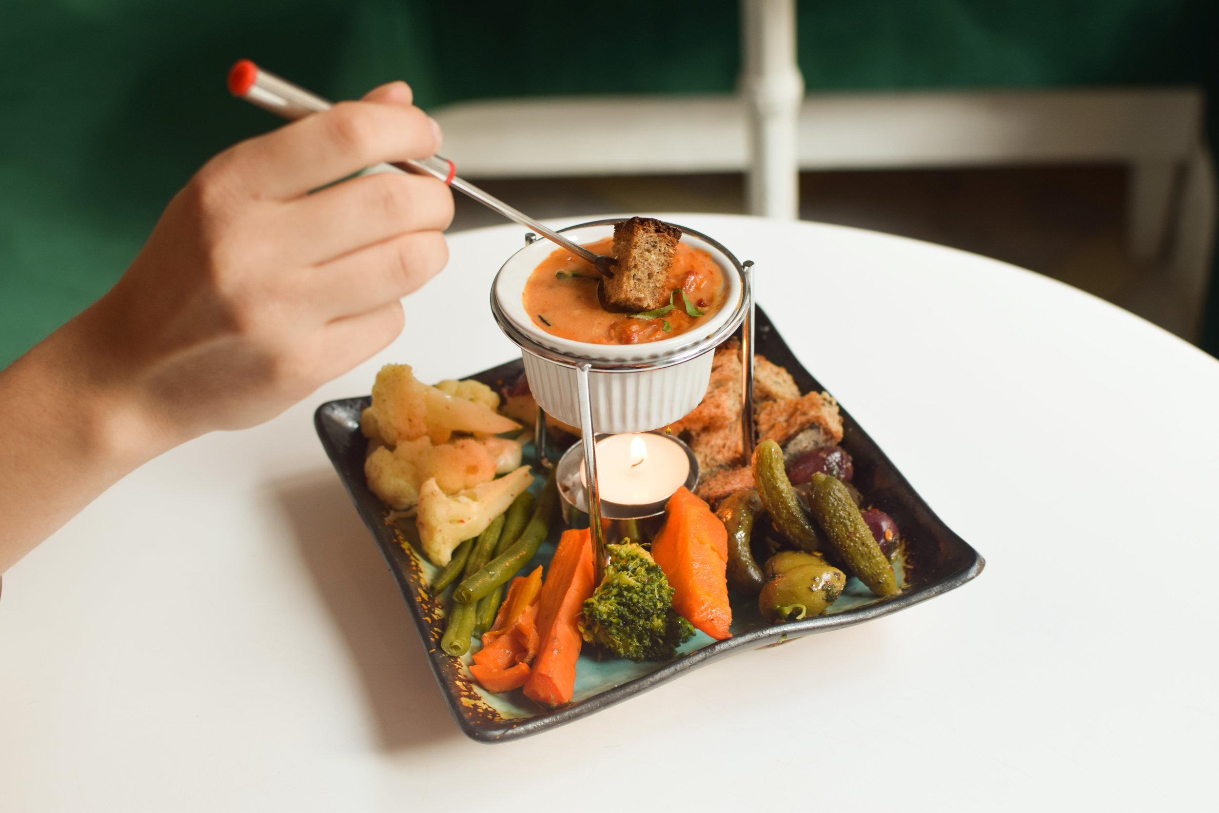 tomato mini fondue hand.jpg