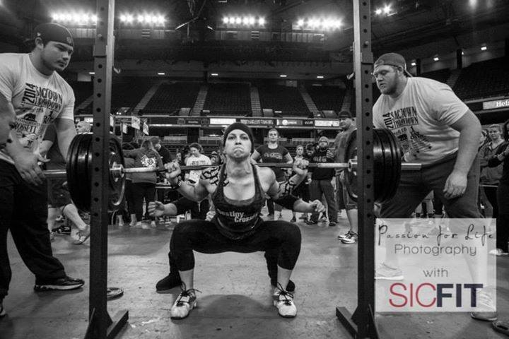 Coach Jessica squatting some big weight at the SacTown Throwdown