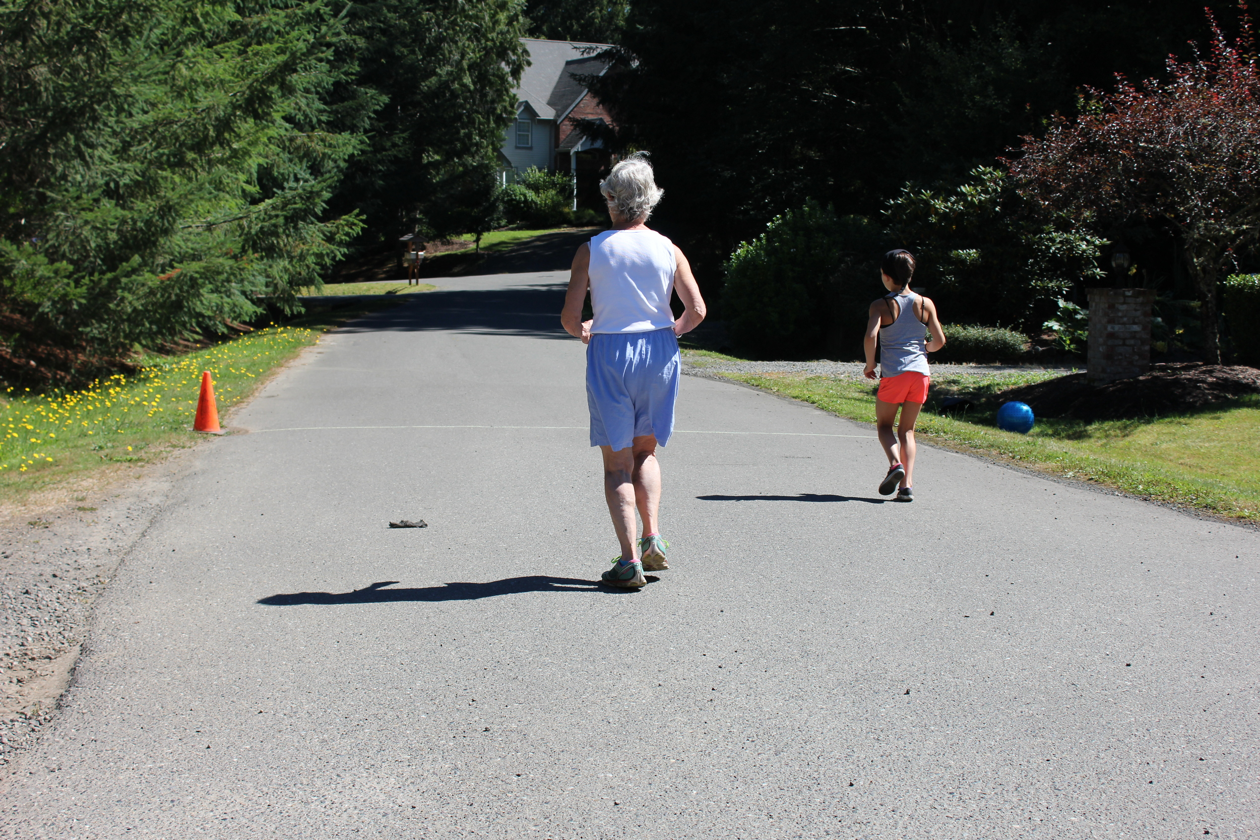 Grandmother and granddaughter working out side by side