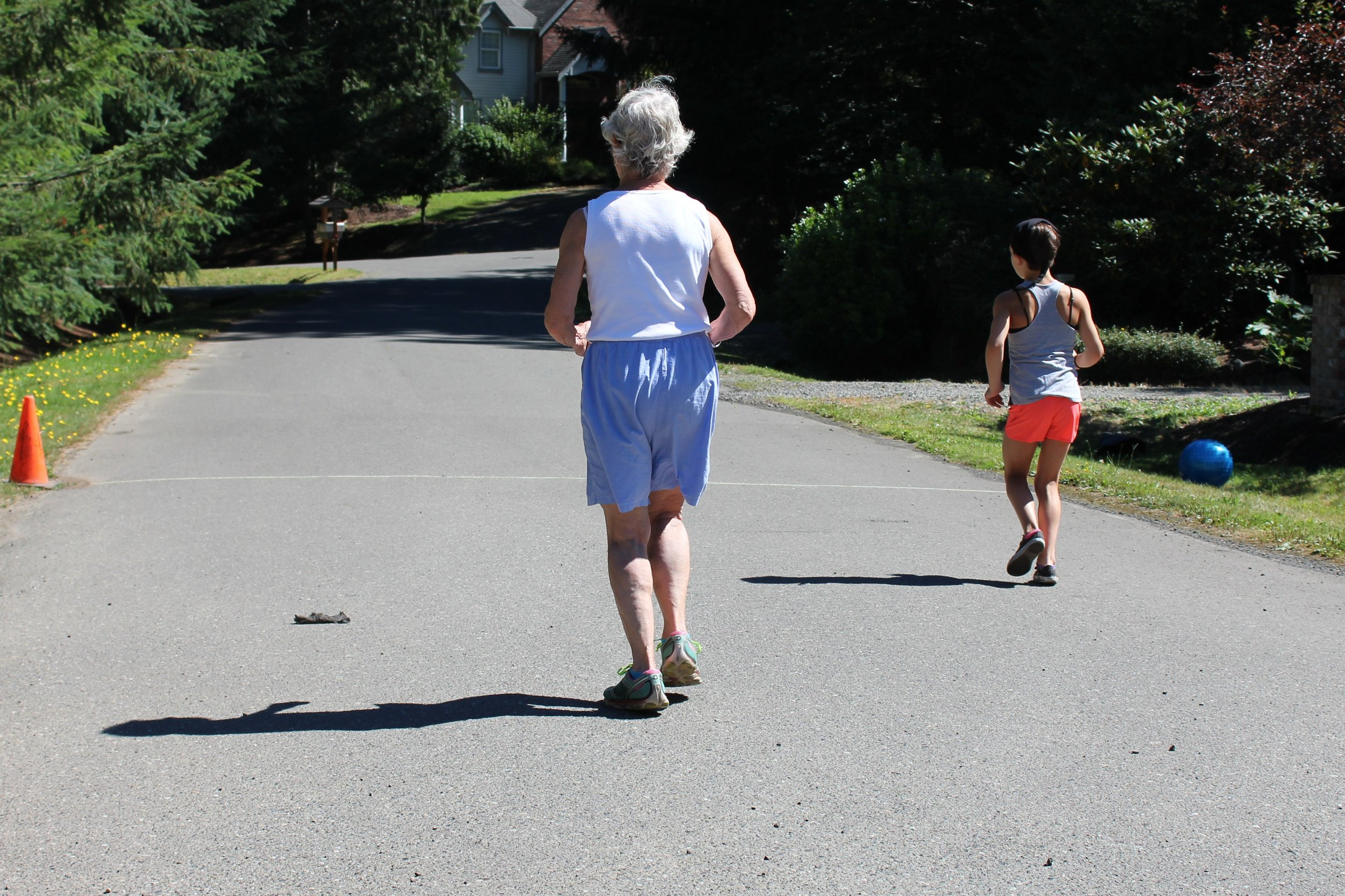 Grandmother and granddaughter pound the pavement together