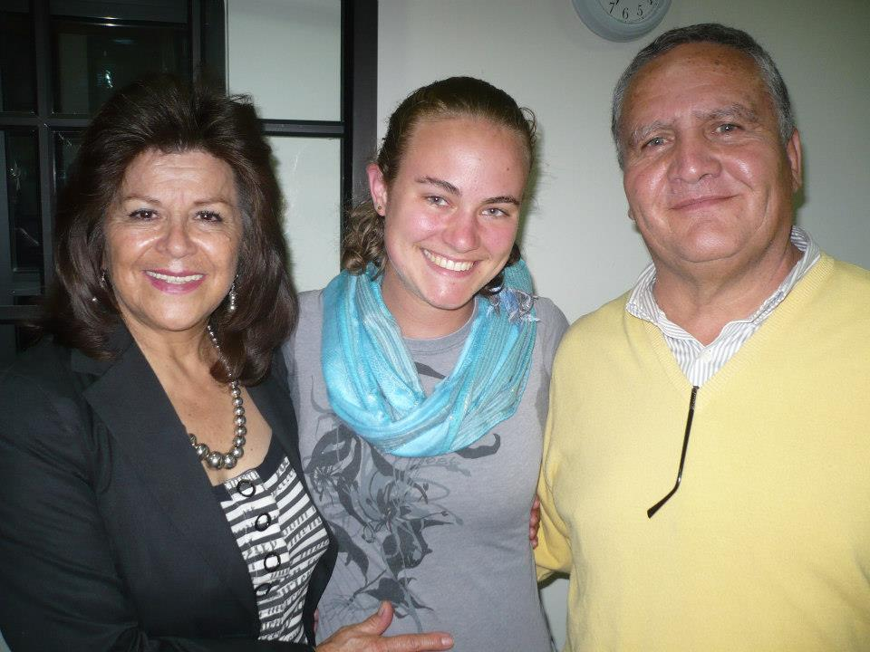 An ACLAS student poses with her homestay family before saying goodbye.