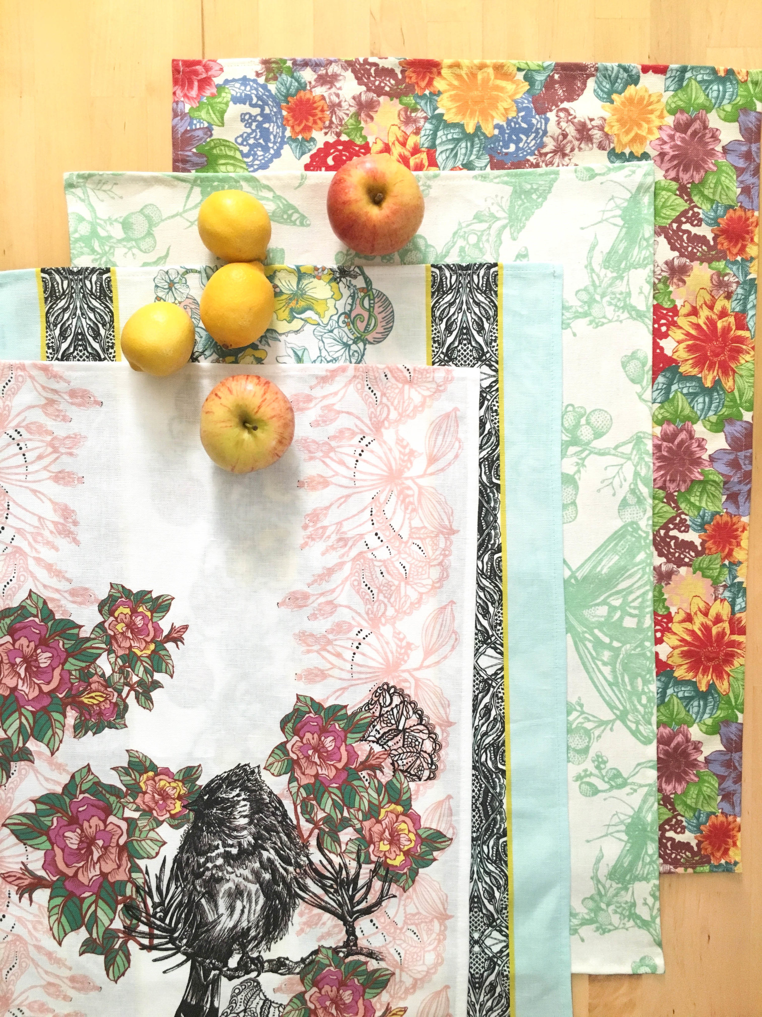 Janice Nelson Designs tea towels displayed with fruit