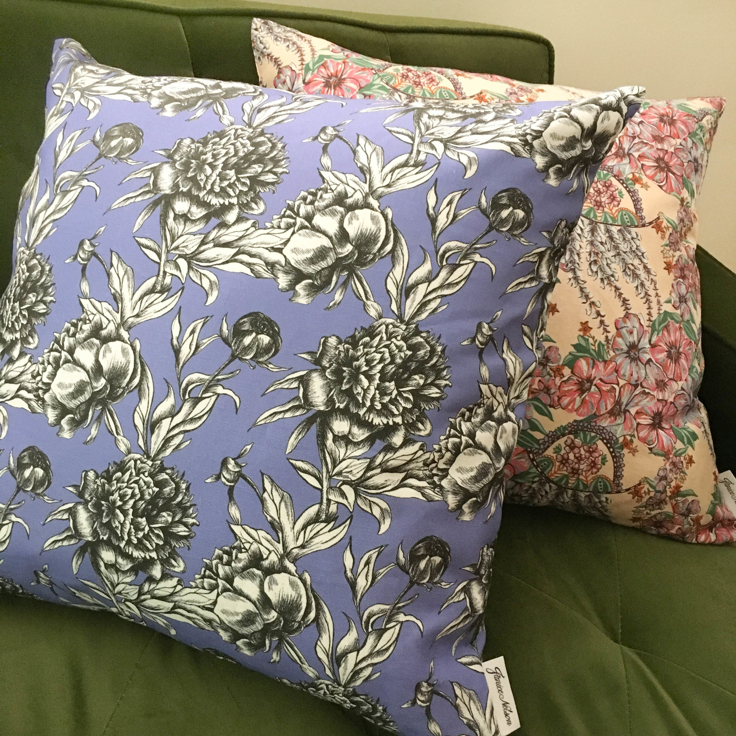 Bold and unique 20x20 Paeonia pillow has illustrative black and white peonies on a purple background