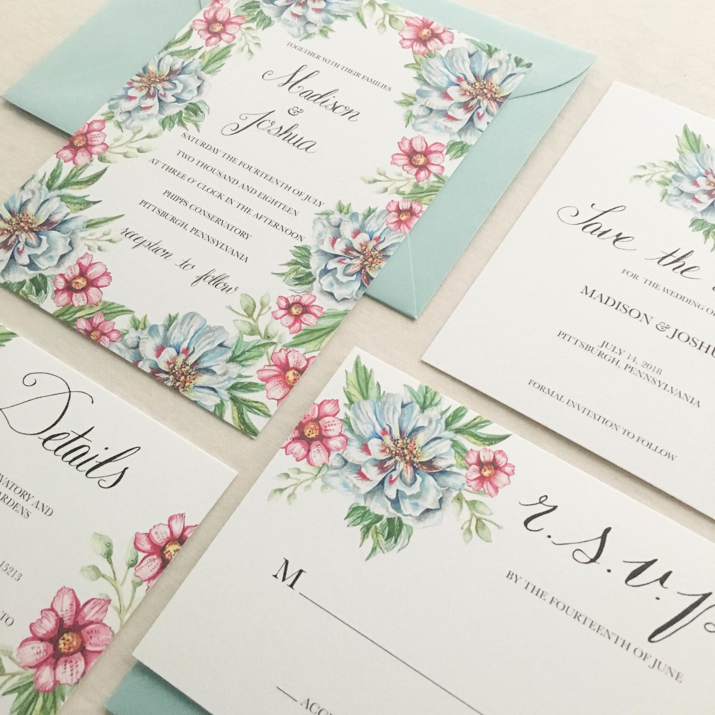 Janice Nelson Made in USA floral border wedding stationery with blue peonies, pink blossoms, and green leaves semi-custom hand painted watercolor wedding invitation details and RSVP custom wedding