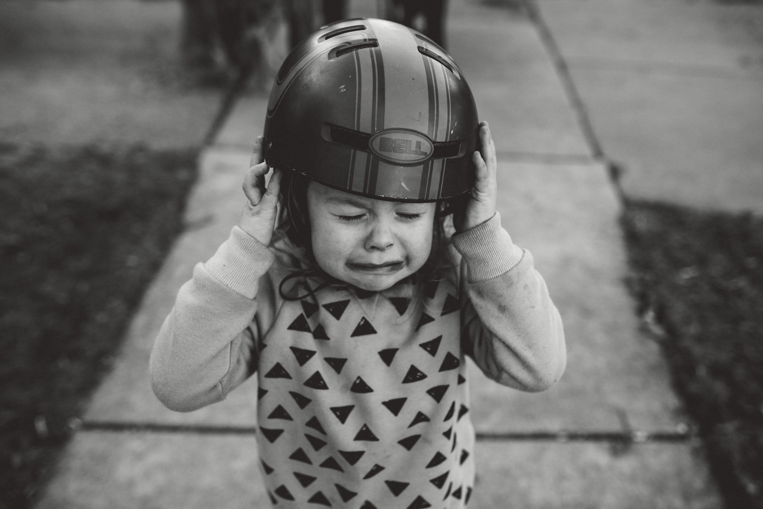 Little boy crying about helmet.
