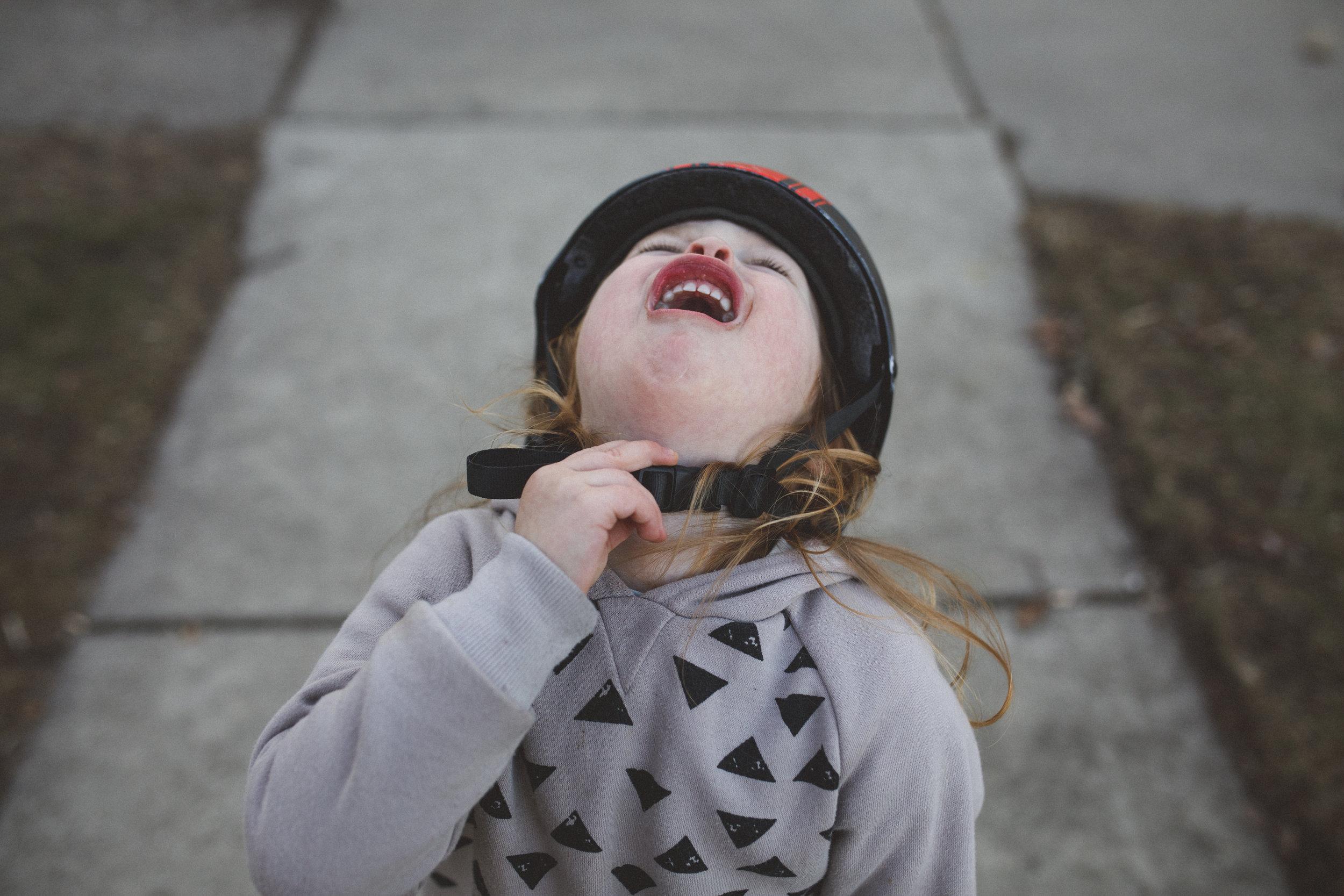 Little boy mad about his bike helmet.