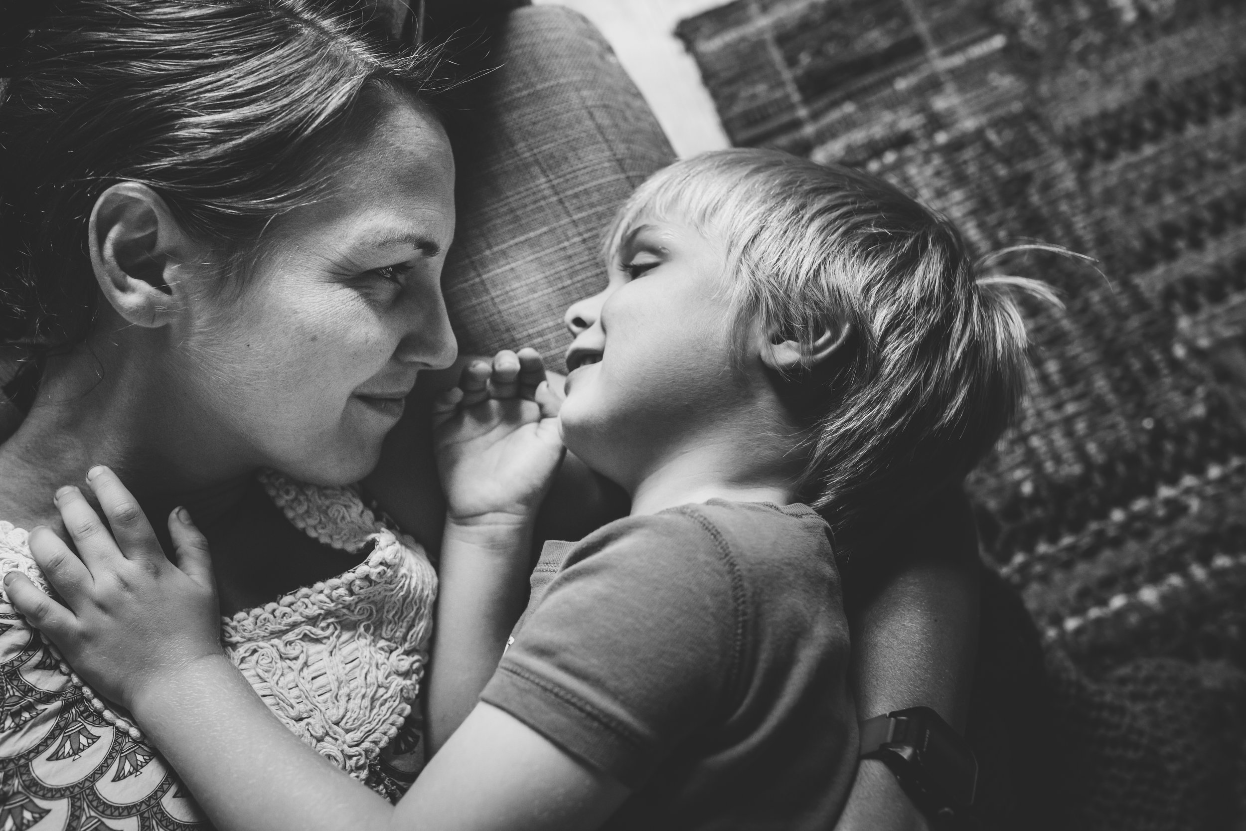 Mom gazing at little boy.