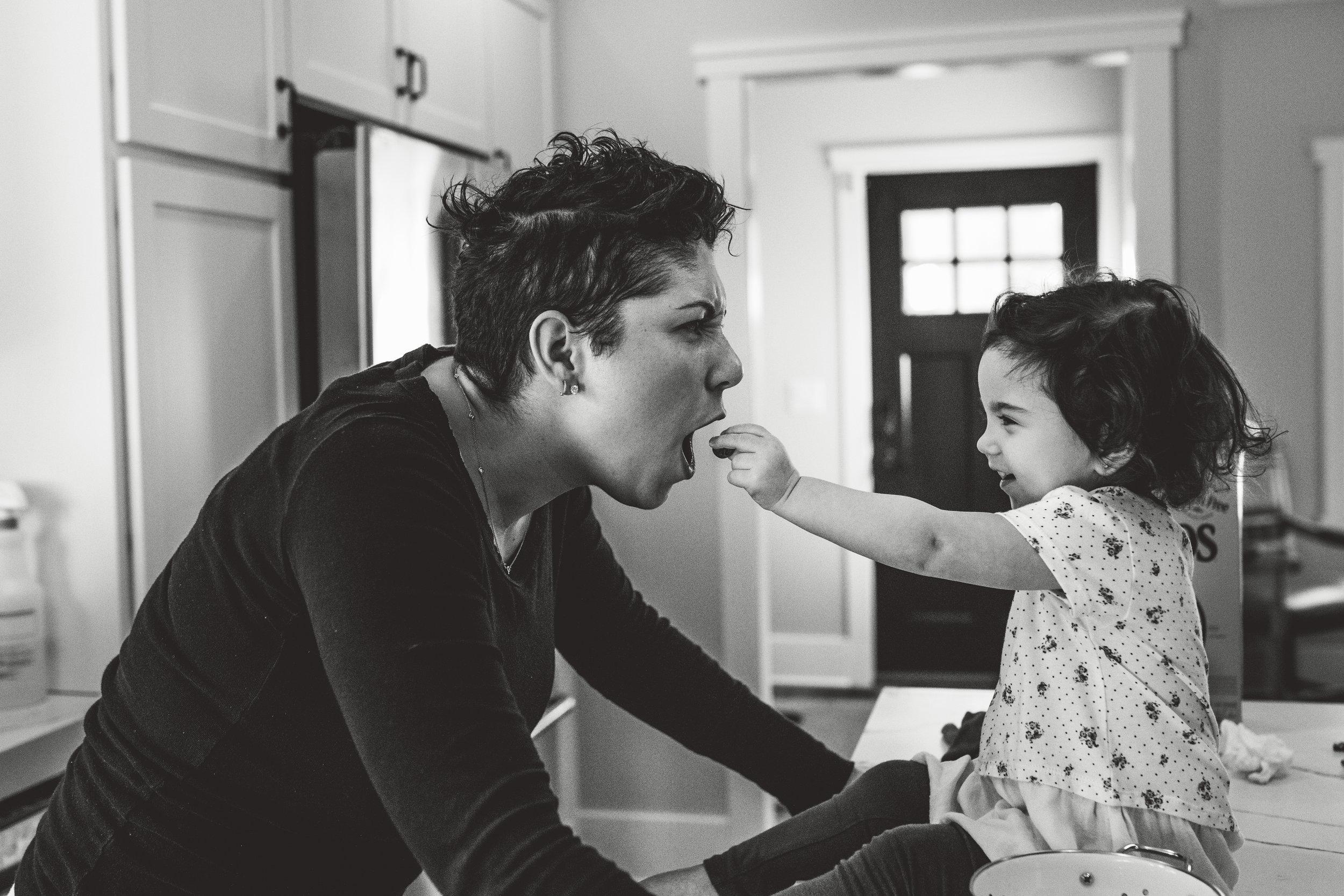 Toddler feeding her mom.