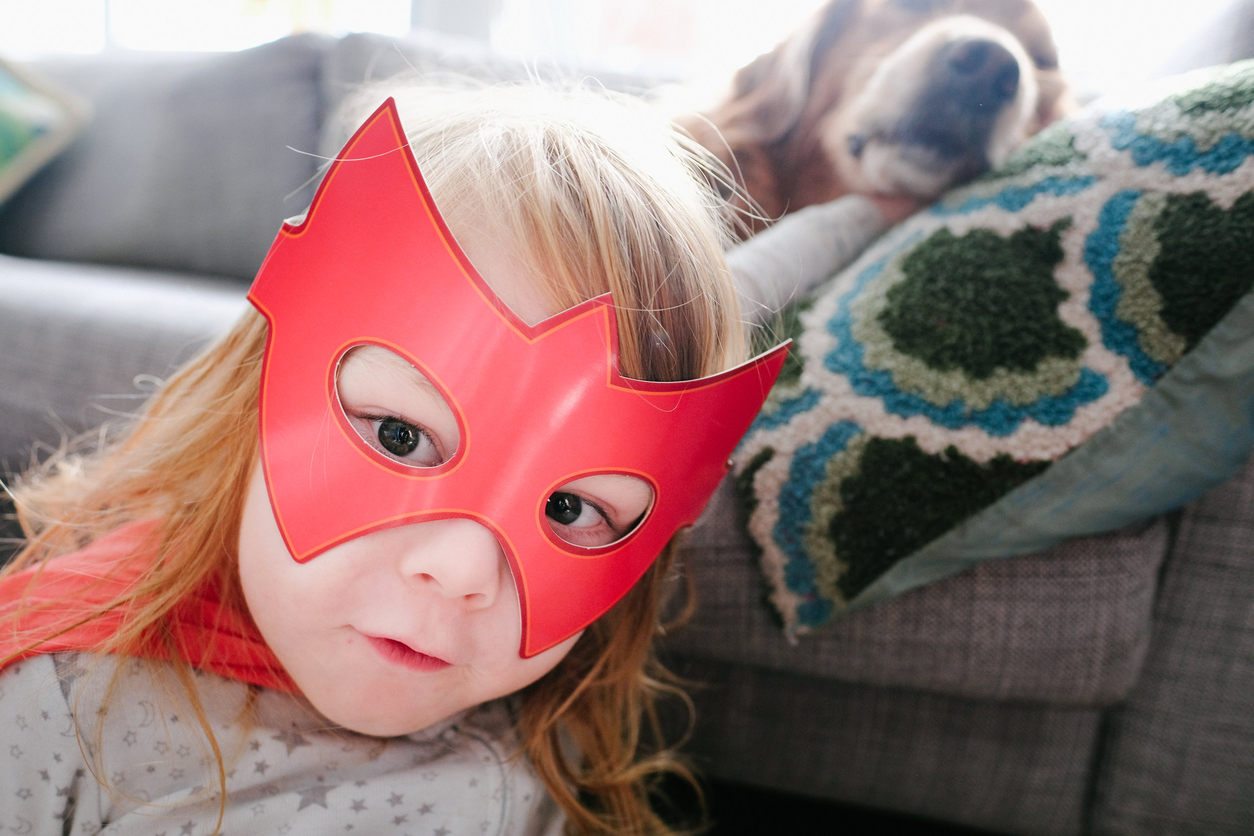 Little boy in superhero mask.
