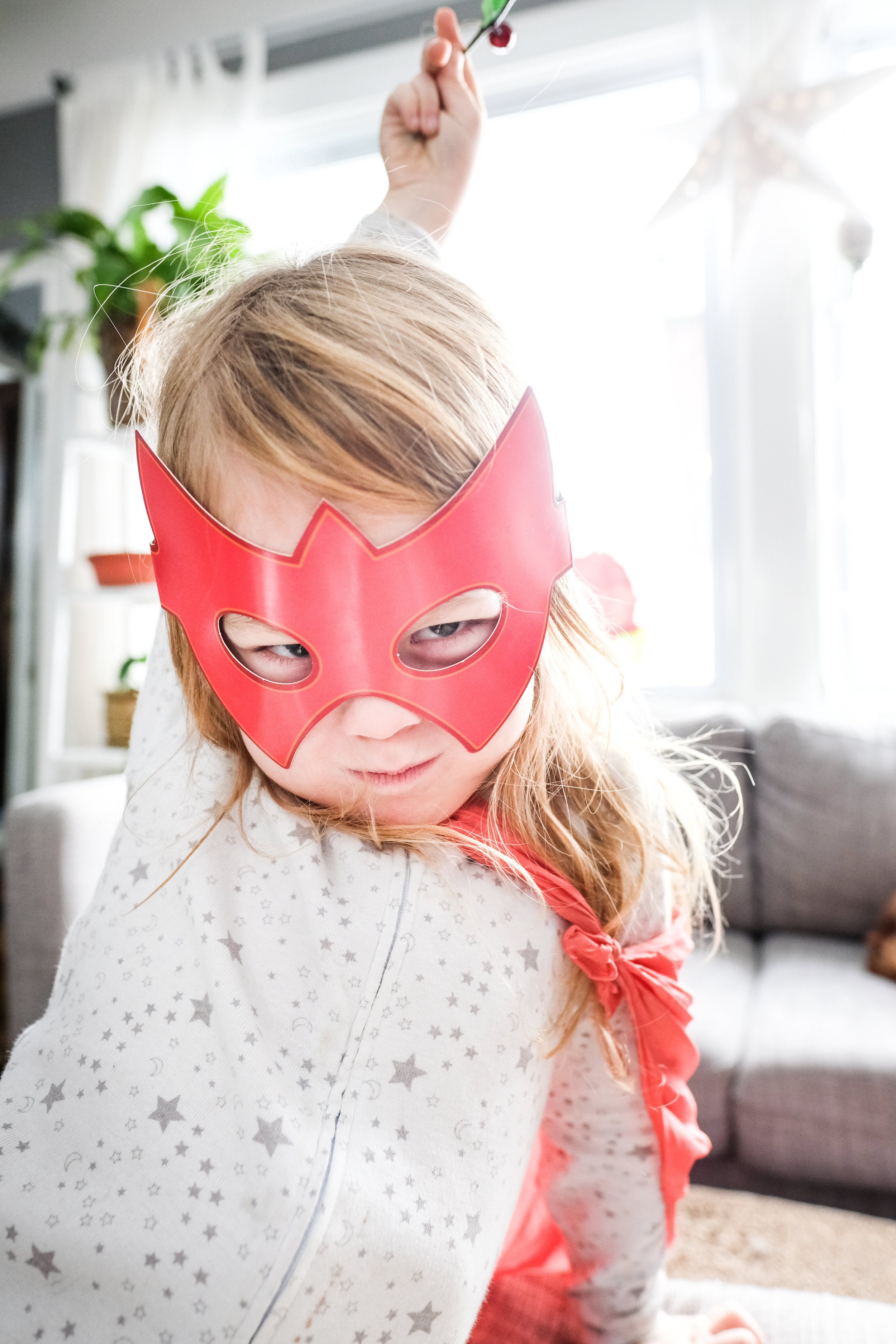 Boy with superhero mask.