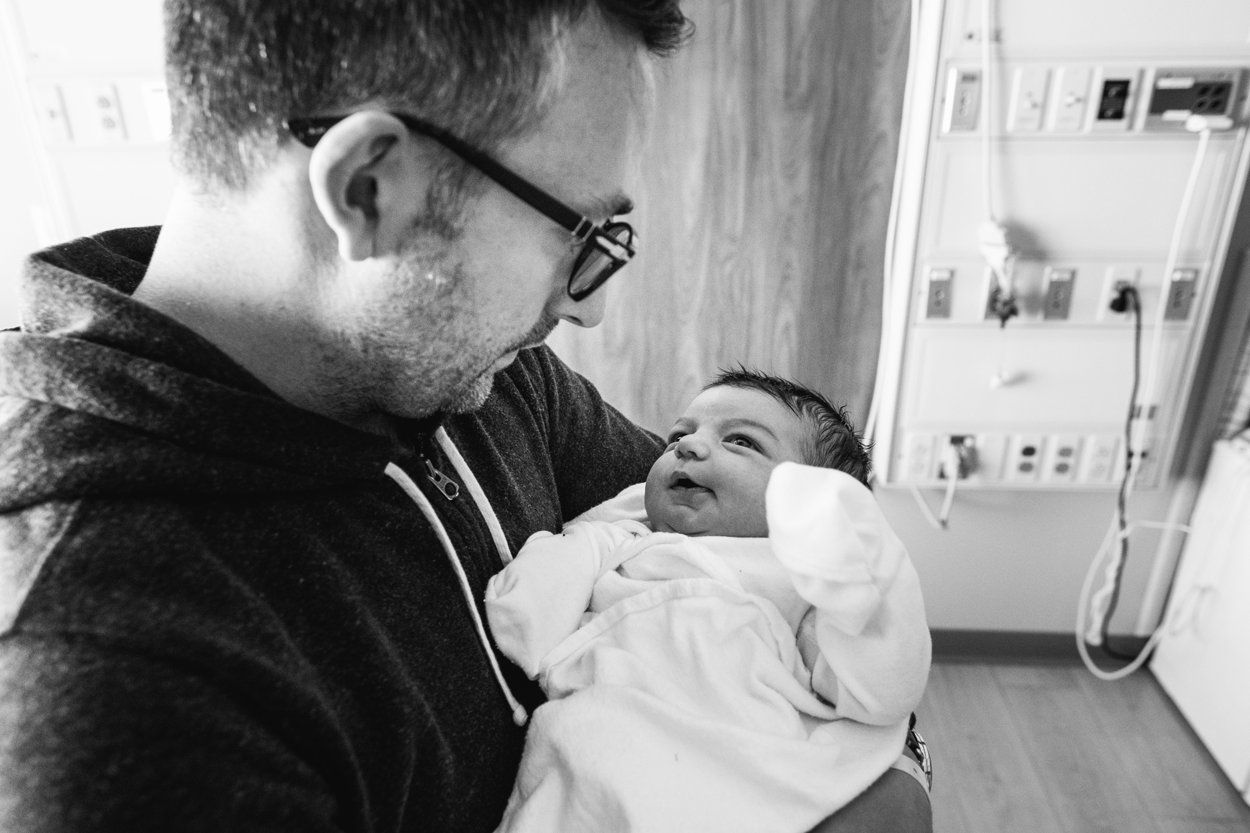 Baby gazing lovingly at dad