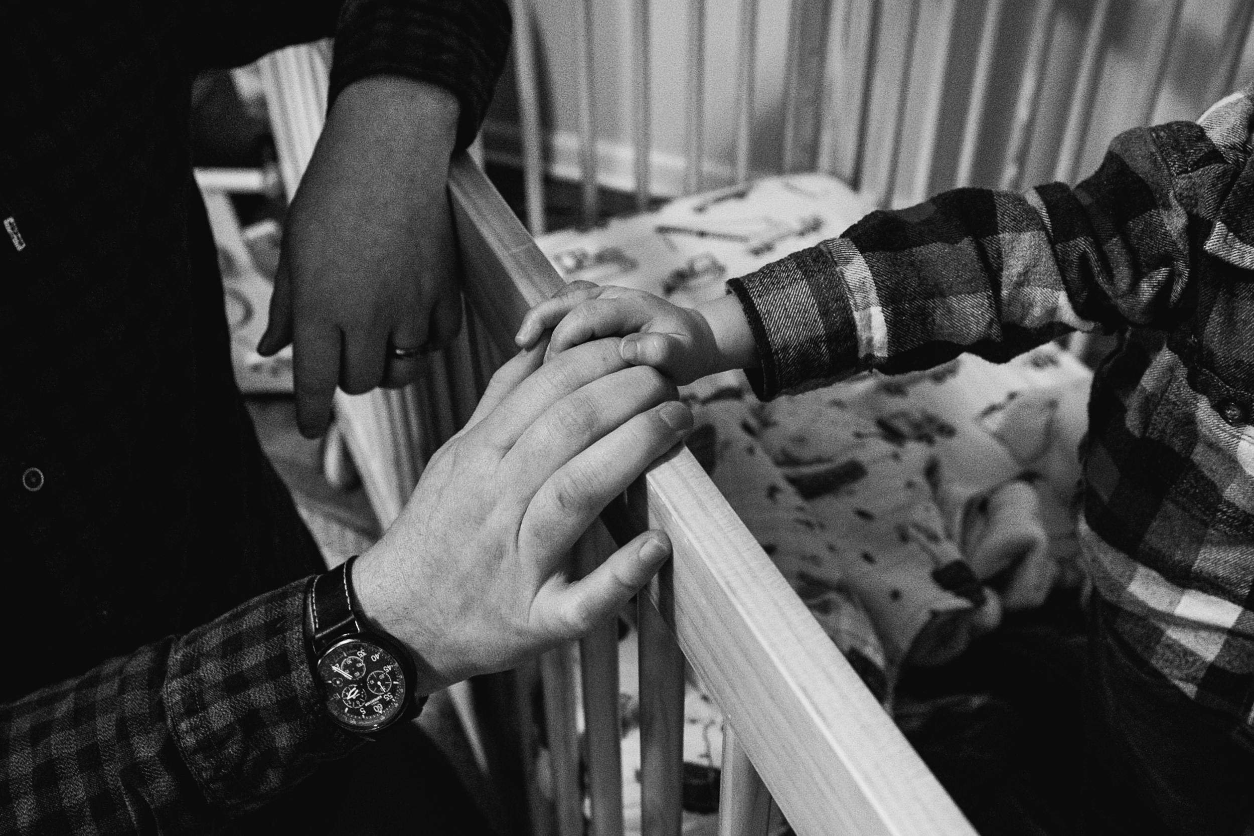 Dad and baby holding hands. Metro Detroit Documentary Family Photographer