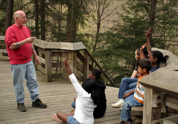 Photo: teacher with students learning about the natural world