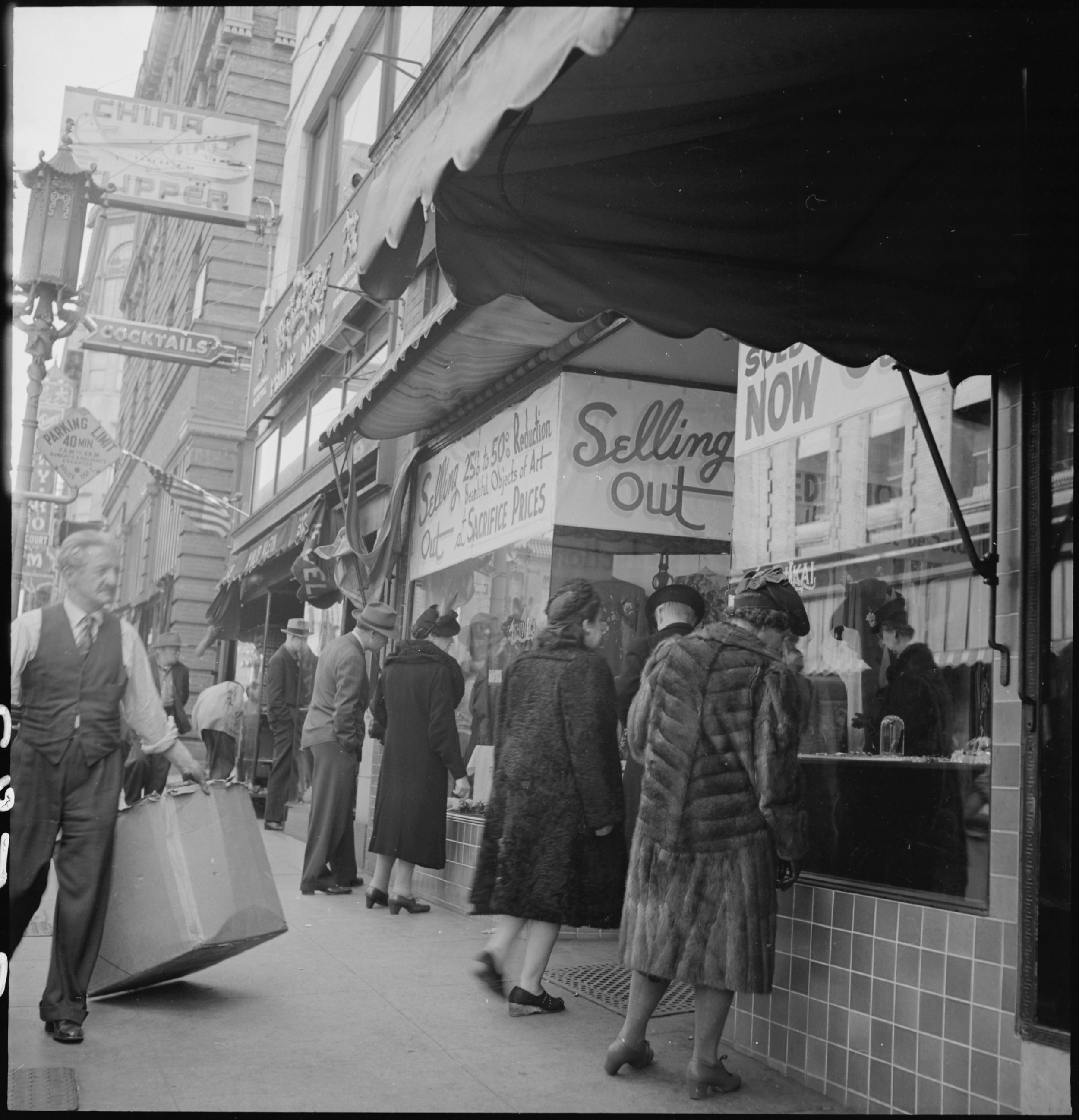 San Francisco, California. A close-out sale- prior to evacuation- at store operated by proprietor of Japanese ancestry on Grant Avenue in Chinatown. The evacuees of Japanese descent will be housed in War Relocation Authority centers for the duration.