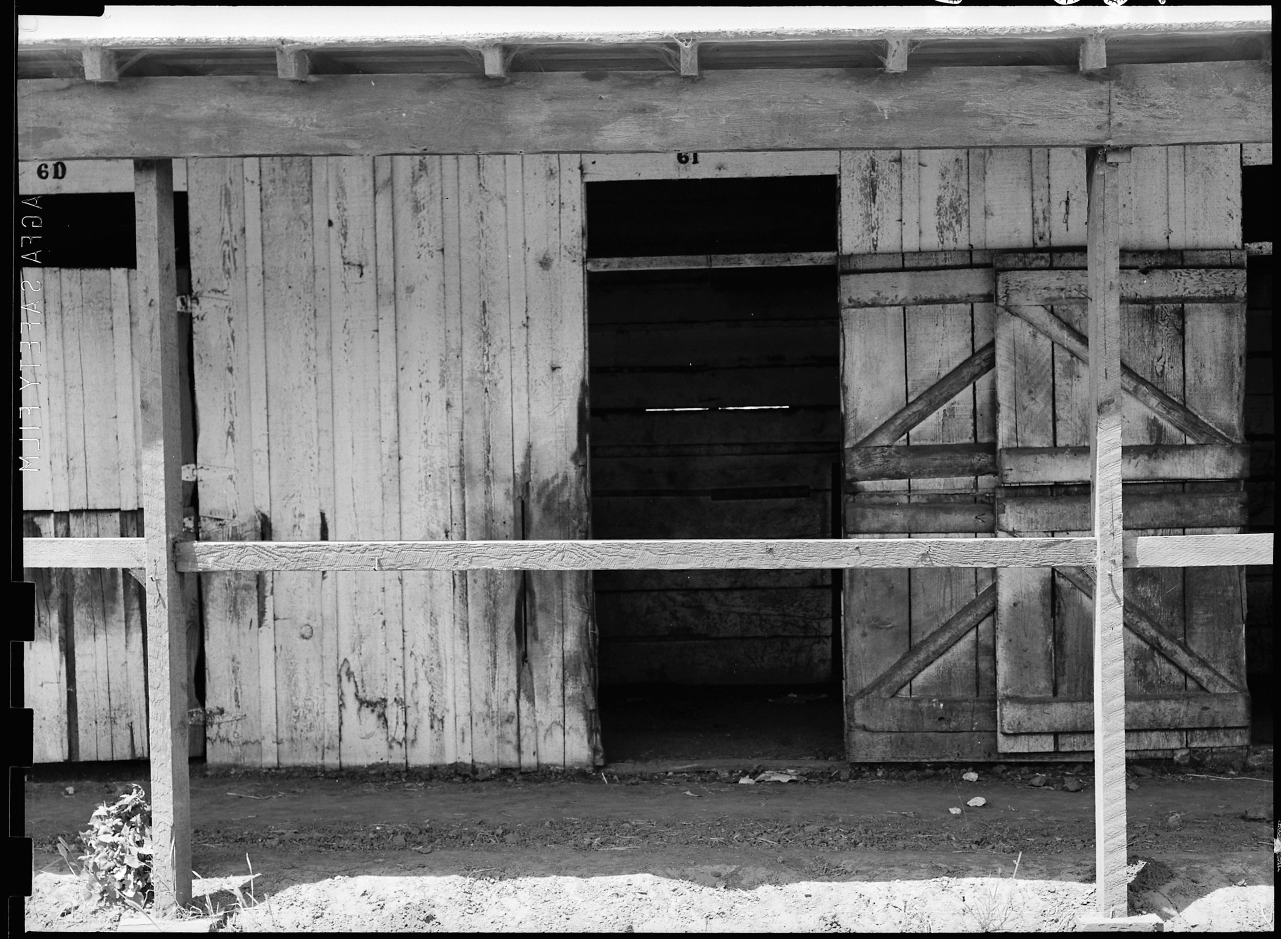 June 16, 1942 — San Bruno, California. A near- view of a horse stall left from days when what is now Tanforan Assembly center, was the famous Tanforan Race Track. Most of these stalls have been converted into family living quarters for evacuated Japanese.