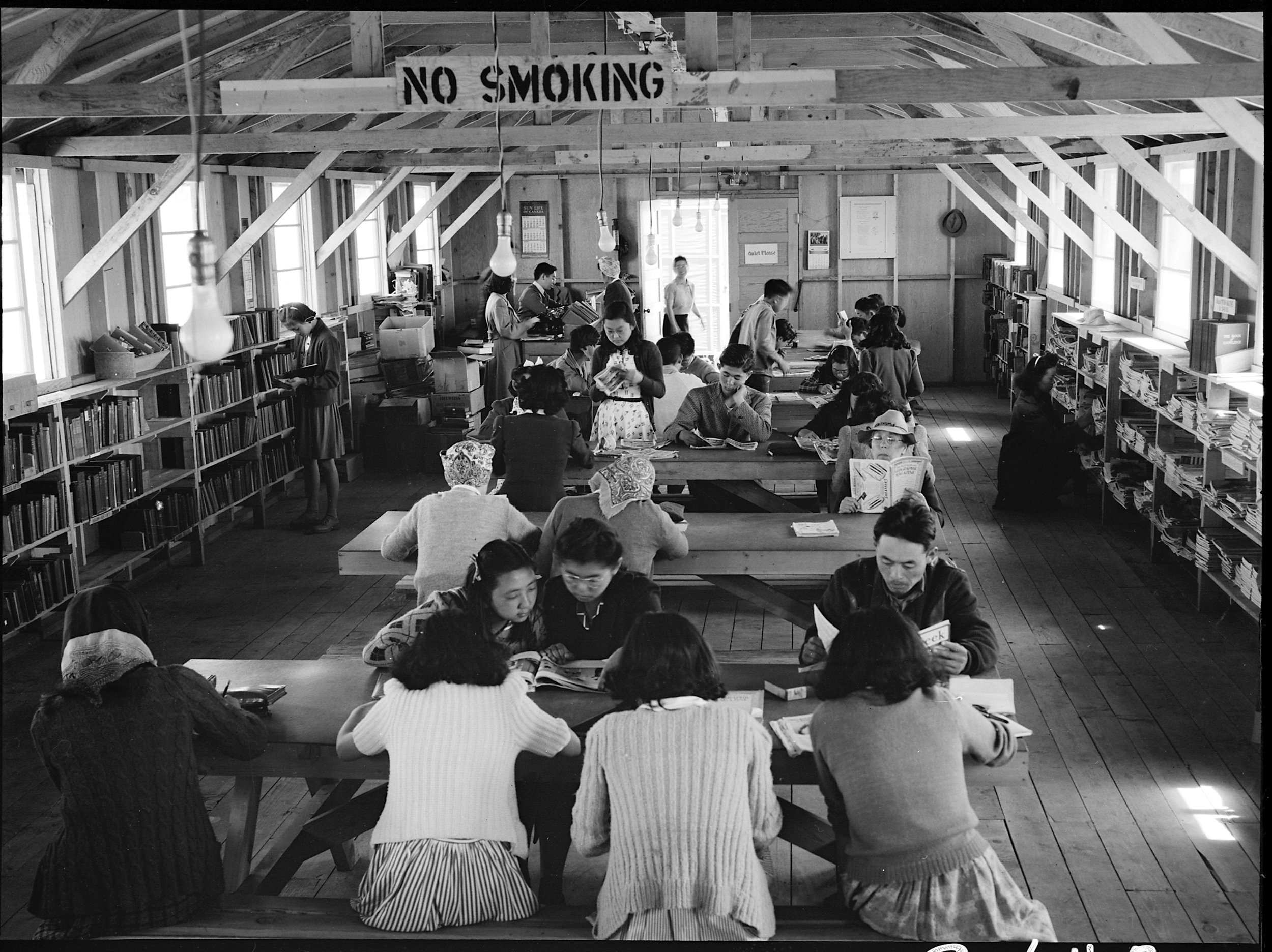 San Bruno, California. A barrack building at this assembly center has been reserved for the library which has just been established with a trained librarian of Japanese ancestry in charge. All books and magazines have been donated and the shelves were made from scrap lumber by the evacuees.