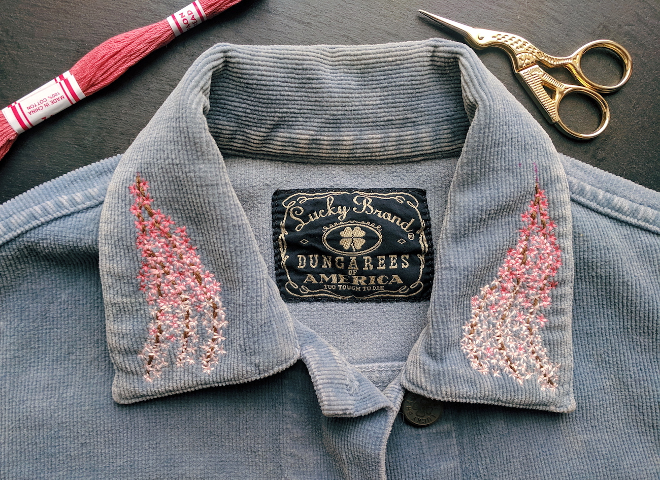 Cherry blossoms on the collar of a vintage corduroy jacket