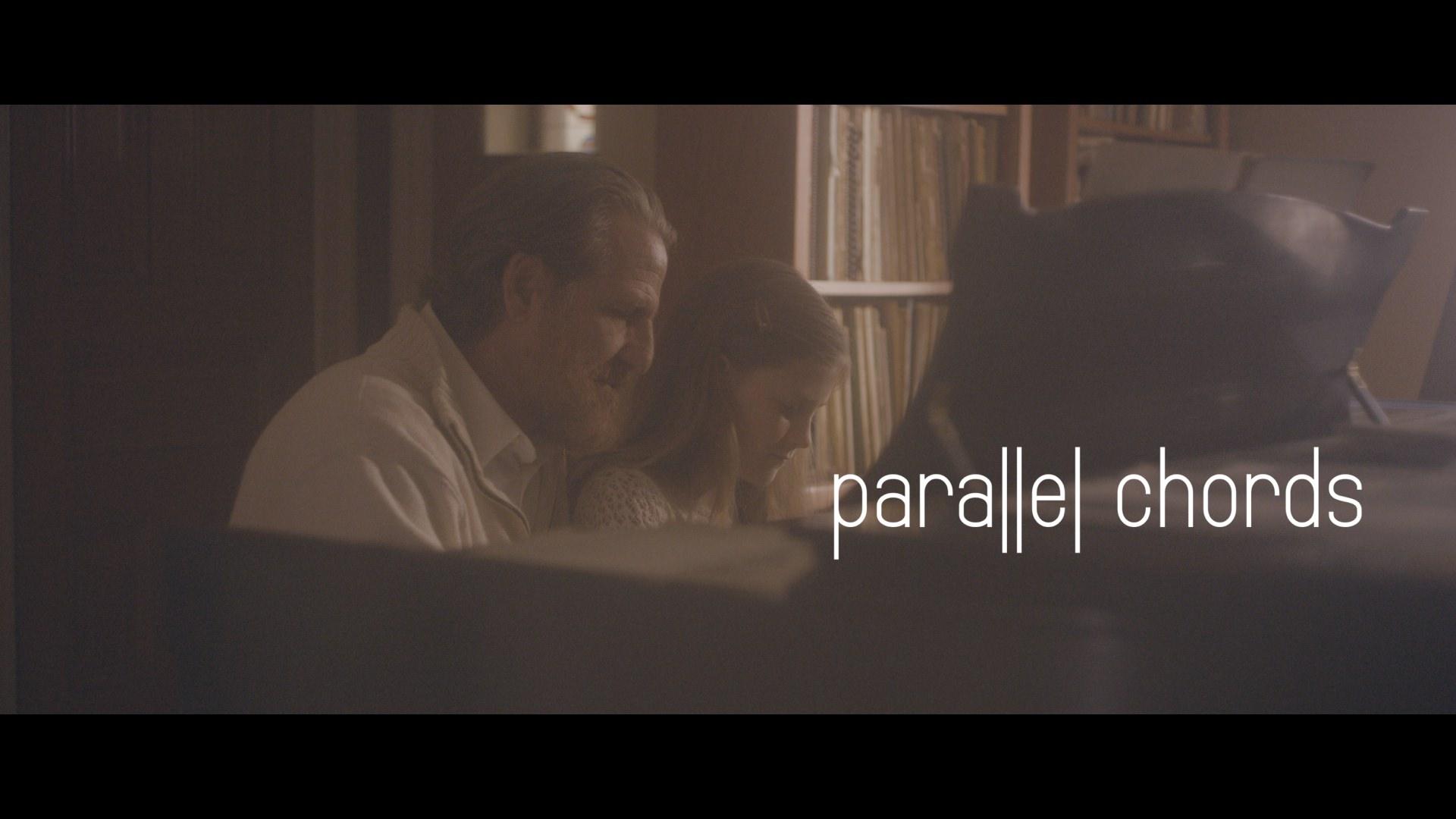 Father daughter memory at piano wlogo.jpg