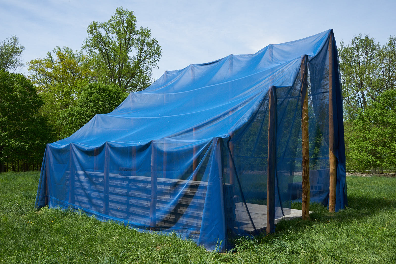 Gabriela Salazar,  Matters in Shelter (and Place, Puerto Rico) , 2018. Coffee clay (used coffee grounds, flour, salt), concrete block, wood, and polypropylene mesh tarp, 12 x 16 x 20 ft. Courtesy of the artist. Photo:Jerry L. Thompson.
