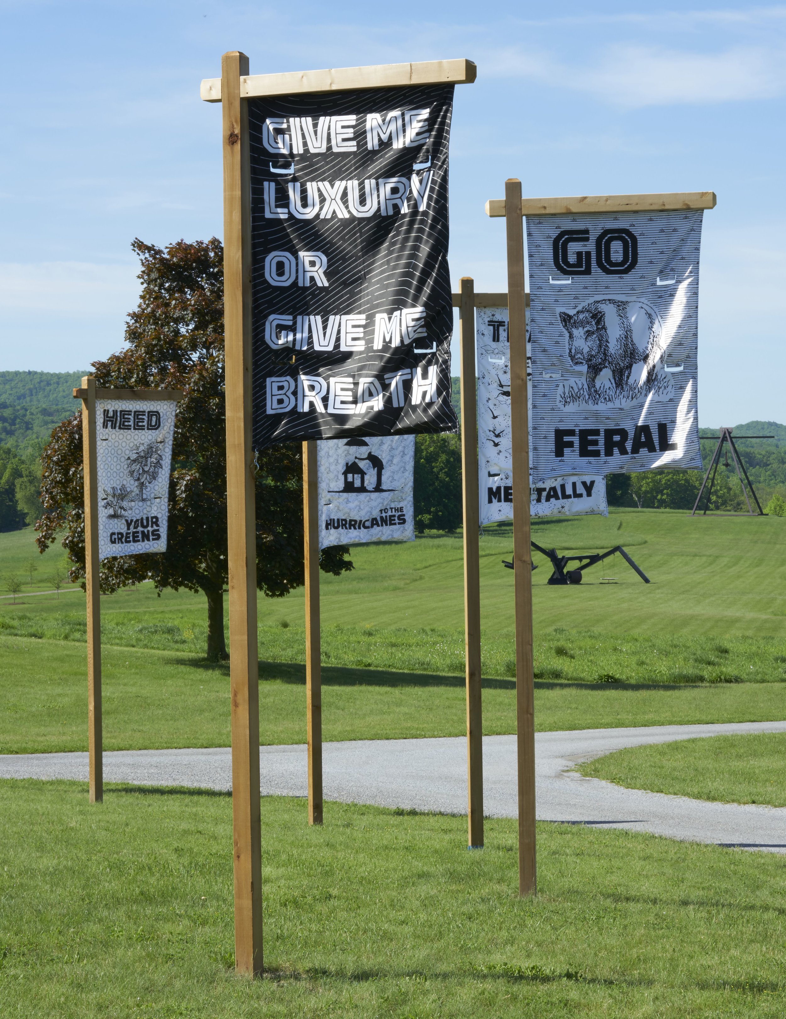 Dear Climate (U Chaudhuri, F Ertl, O Kellhammer, M Zurkow),  General Assembly , 2018. Circle of nylon printed banners on wood poles, 12 ft. high, 84 ft.diam.; each flag 60 x 36 in.Courtesy of the artists. Photo: Jerry L. Thompson.