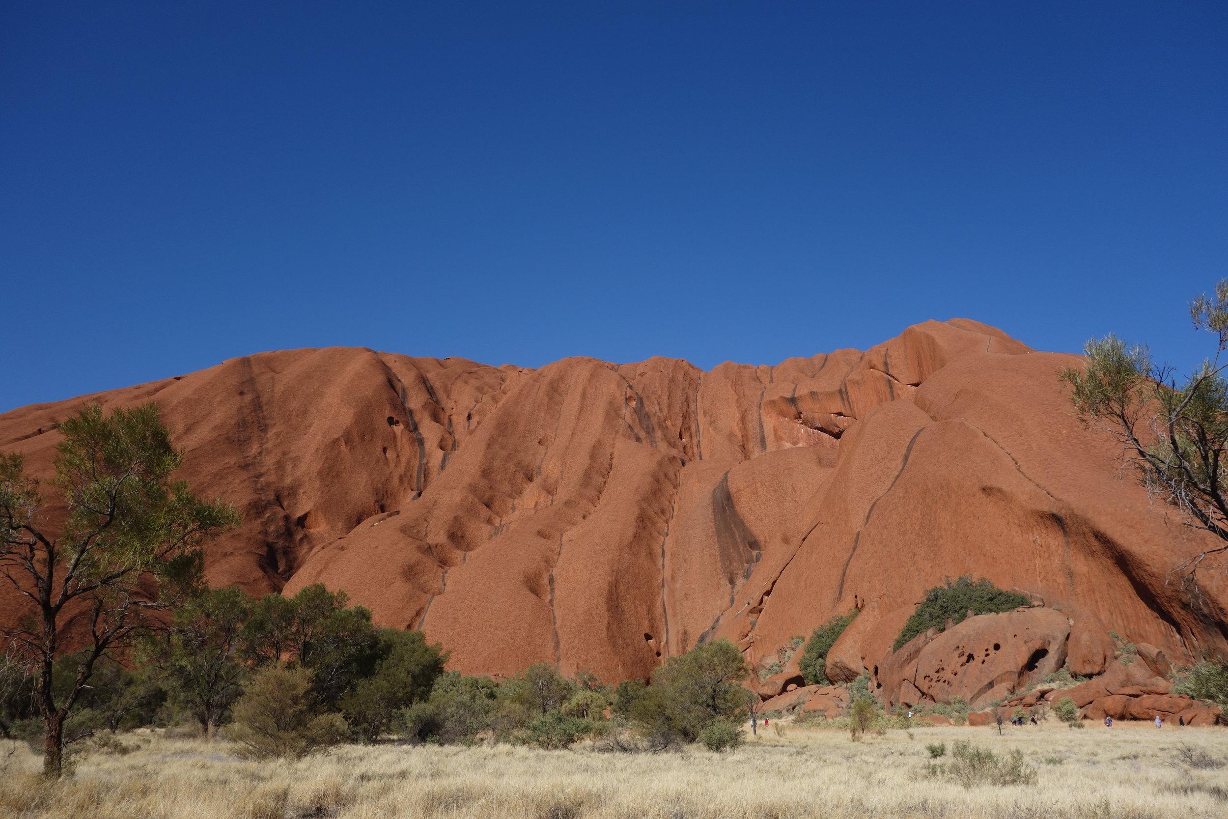 Uluru with beautiful dark streaks where the water has rushed down in the wet season
