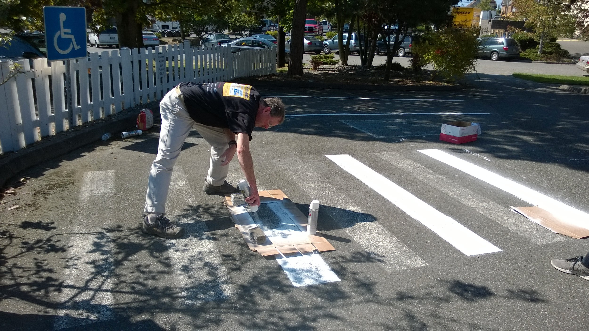 Restriping the parking lot at Cocoon House