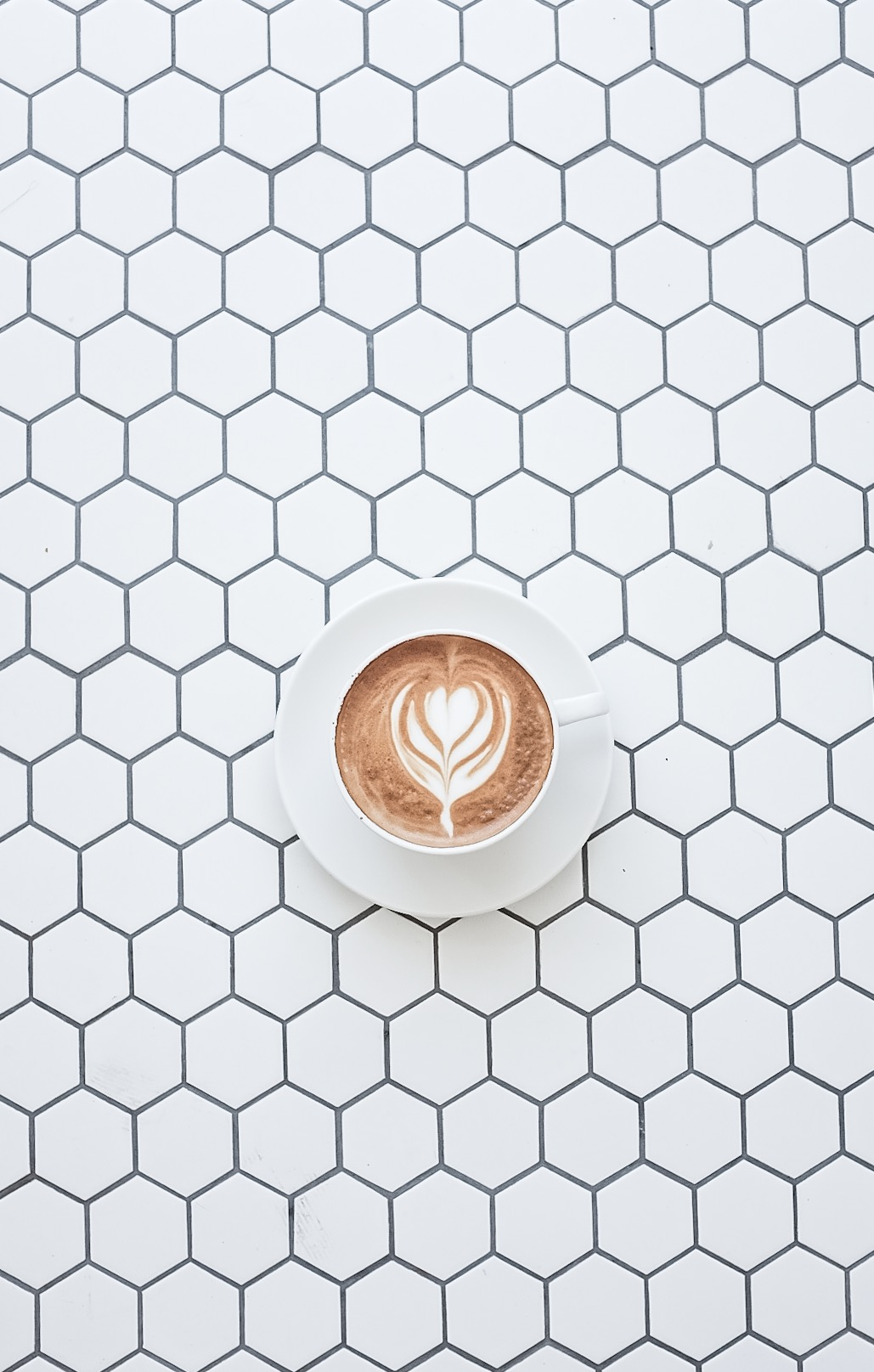 Nice latte art on pretty tiles.