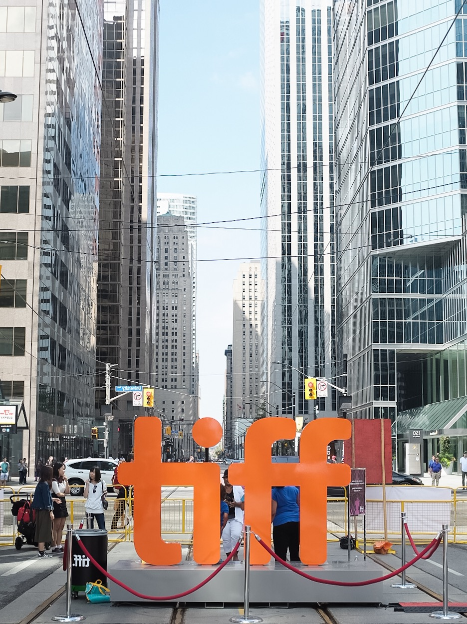 The iconic TIFF sign rests at the same spot each year but there is always a lineup to take a photo with it.