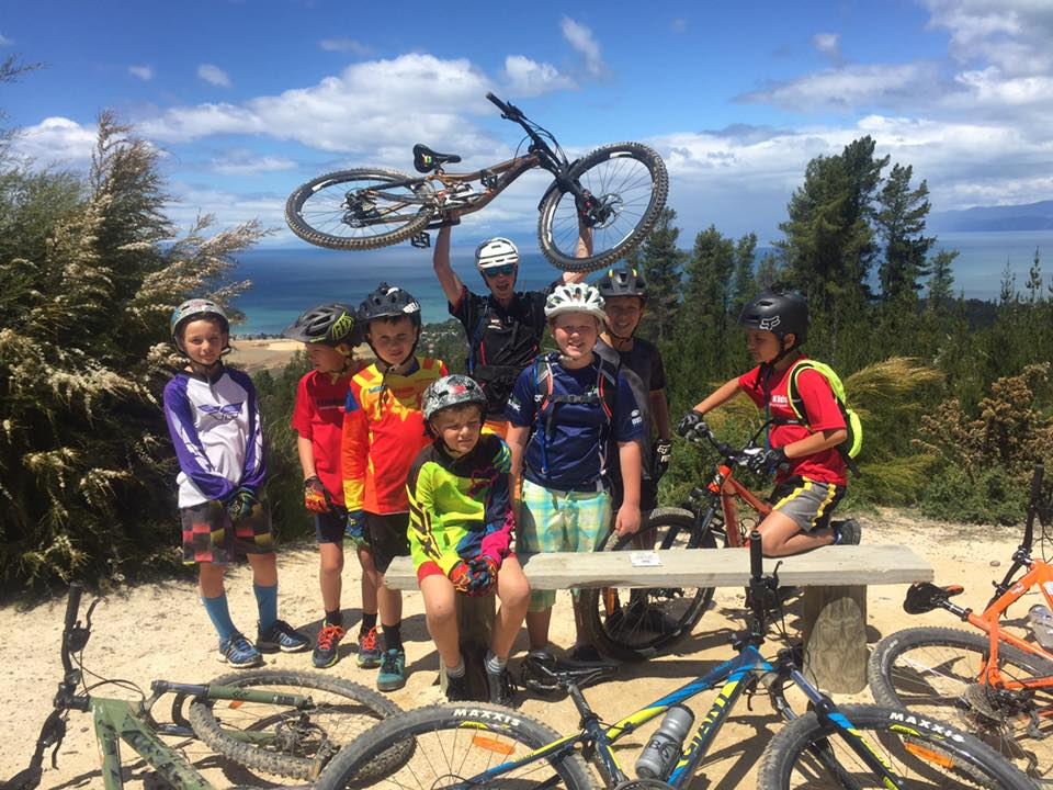 The 'Mini's' group squint into the sun for a quick photo, before getting back to shredding Kaiteriteri Mountain Bike Park with graduate and now coach Callum Bryant on the last day of term 'Shuttle Day!'