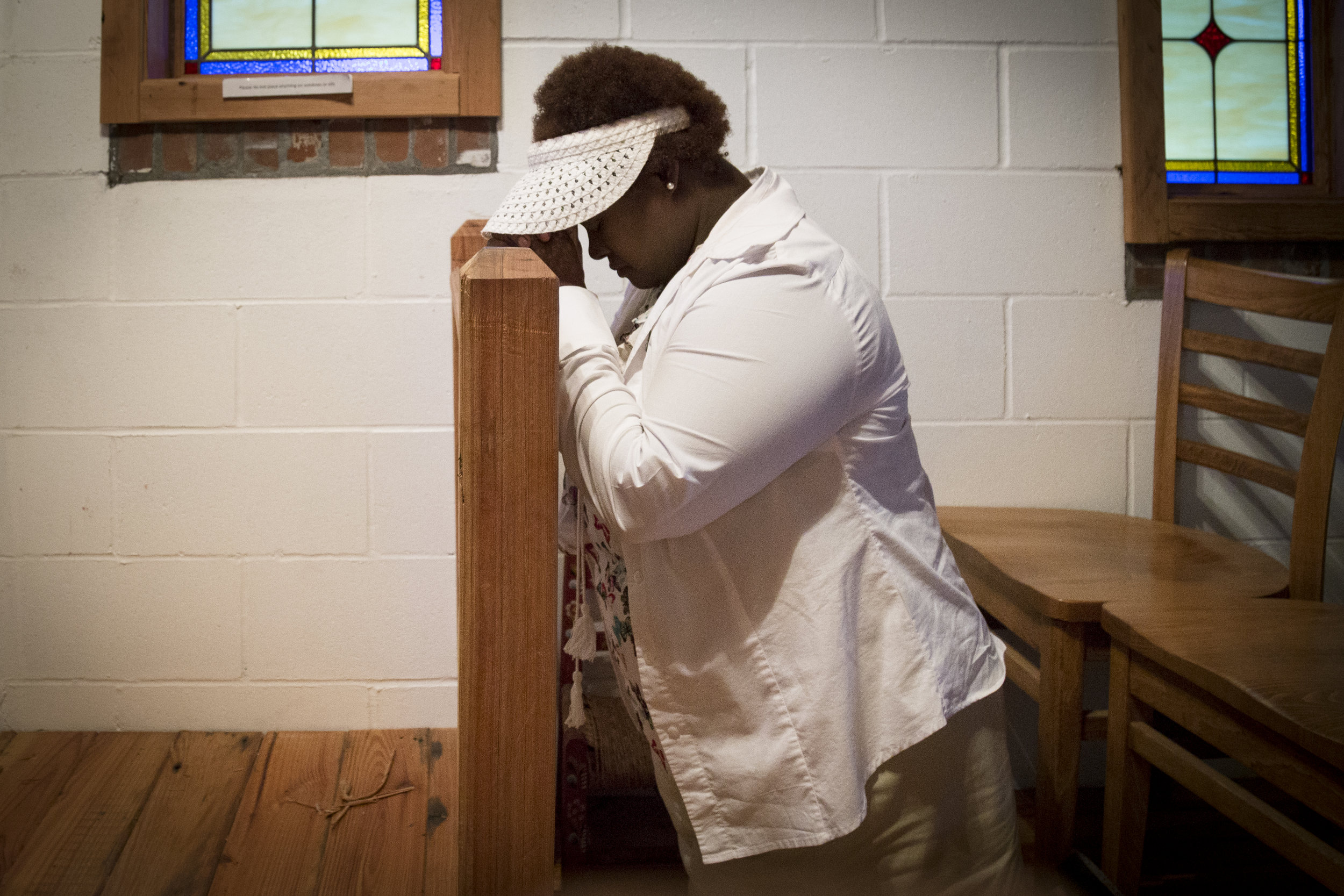 """""""This was my place of solace,"""" says TeeCervantes, a former local, who has been coming to the church for """"decades."""" She now resides in Arizona, and stopped by the church while home to visit family."""