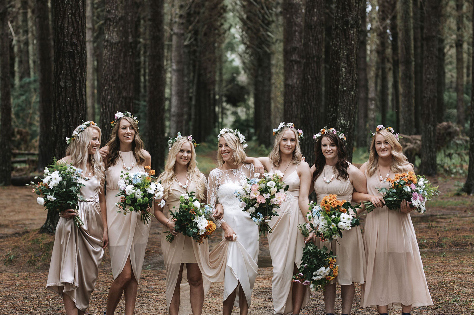Beautiful nude tones on the eyes, soft coral lips and glowing natural skin was the look chosen for the bridesmaids and a slightly brighter coral lip for the bride. It worked so well on each one and went with the organic look that was created with the flowers and hair.