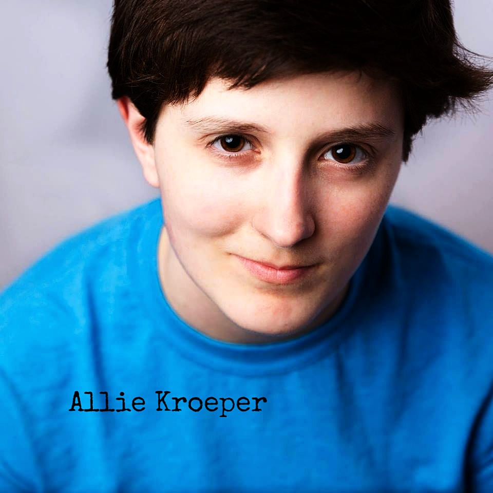 Allie Kroeper is a New Jersey-based playwright, actor, and comedian. A graduate of Rutgers University with a Bachelor's in English, a minor in Theater, and a certificate in Creative Writing, she is giving back to the Rutgers community by working as the Academic Programs Coordinator for Douglass Residential College — her alma mater within her alma mater. She is currently in the improv conservatory at Magnet Theater and studying acting under Maria Psomas & Anthony Simone. Allie is constantly writing plays, novels, and poetry. Most importantly, you will almost always see Allie wearing a hat.