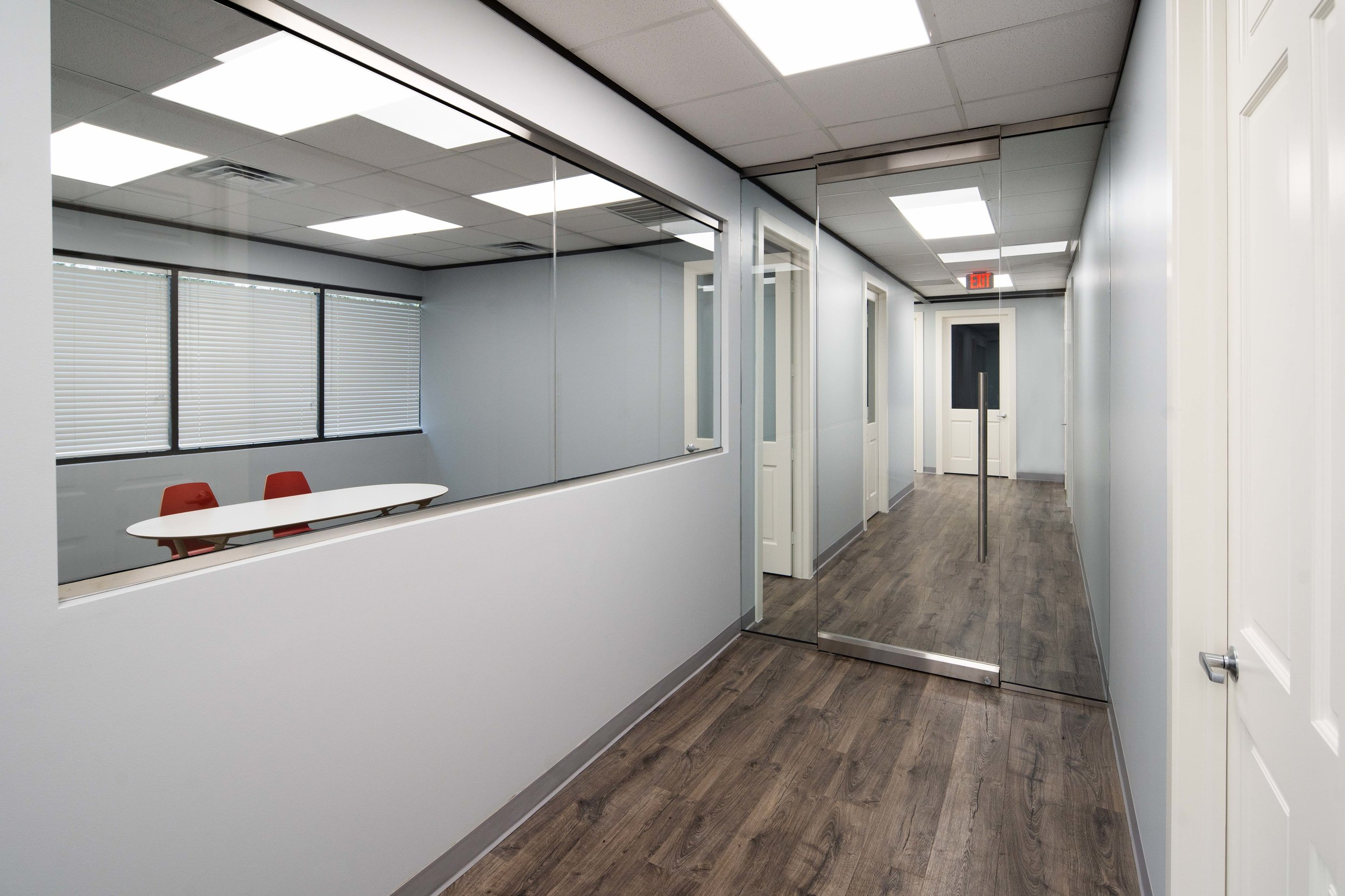Commercial remodeling project. Beautiful frameless glass doors, wood floors, renovated bathrooms, meeting rooms, office spaces and conference rooms. This building was completely customized in order to fit the needs of this business.