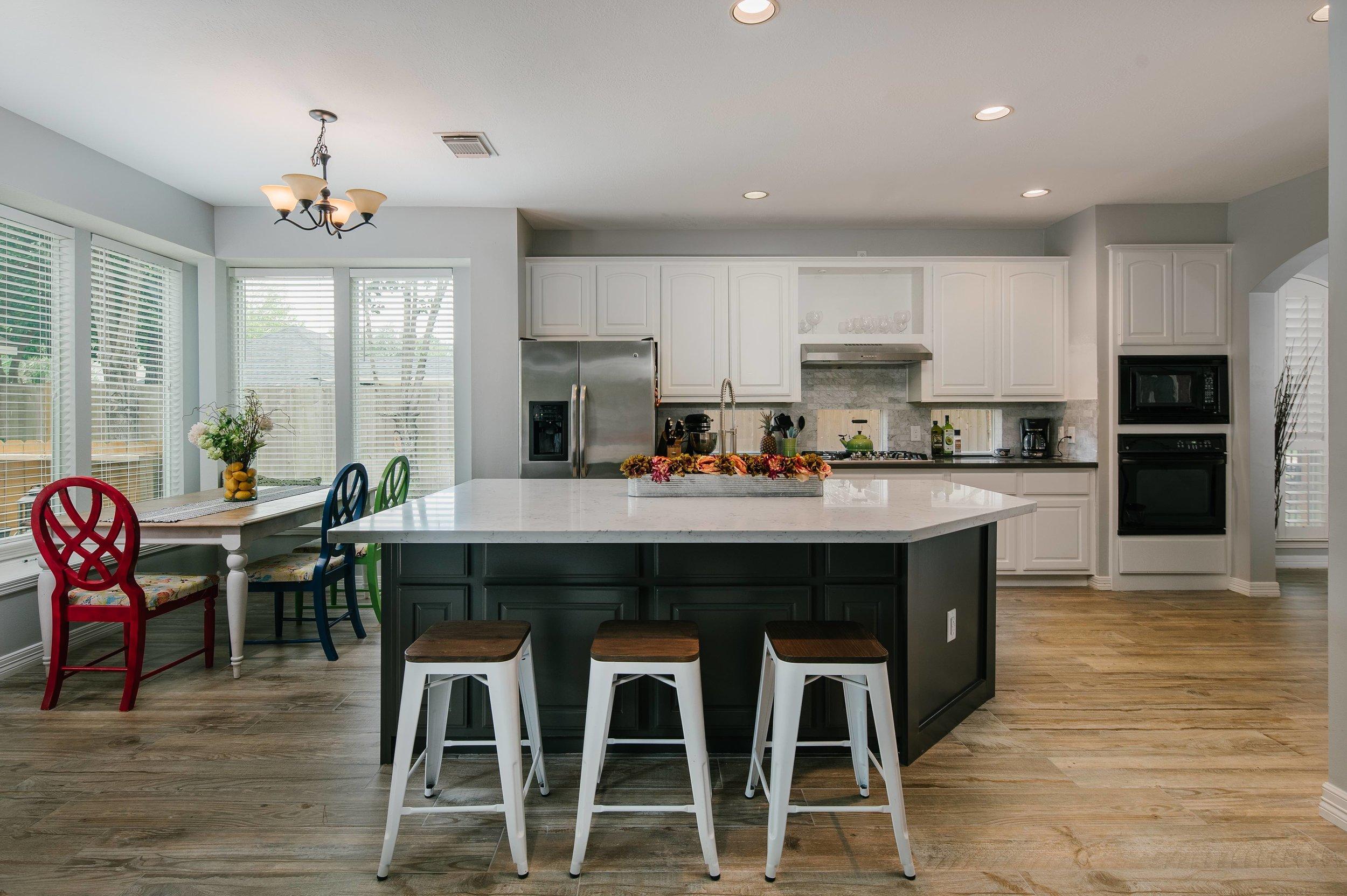 uKitchen Remodel. Quartz countertops, shaker style cabinets, white cabinets, black cabinets, woodblock tile floor, black quartz, white quartz.