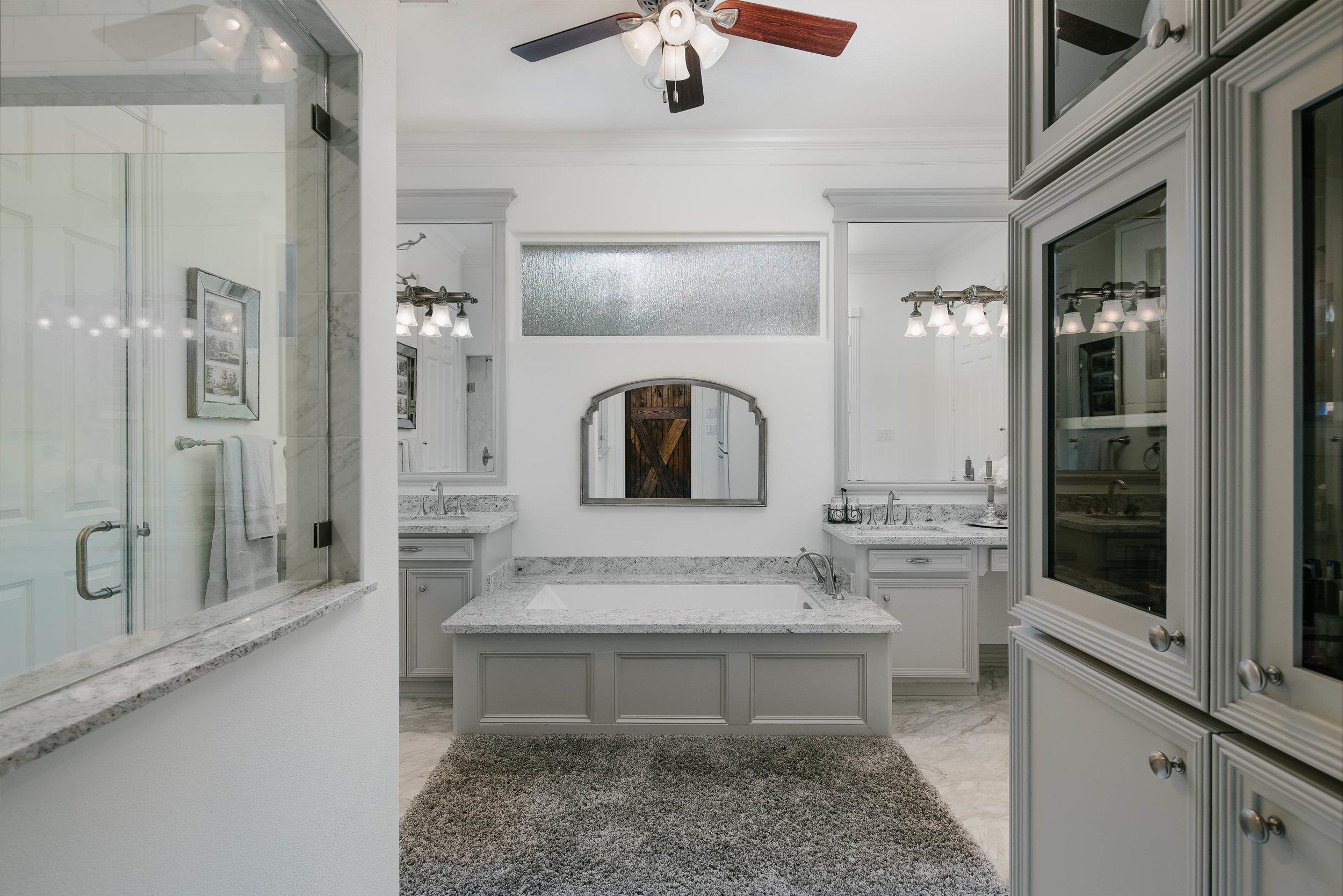 Master bathroom remodel. Grey master bathroom, walk in shower, undermount bathtub, grey marble countertops, white paint, grey paint, grey tile, subway tile.