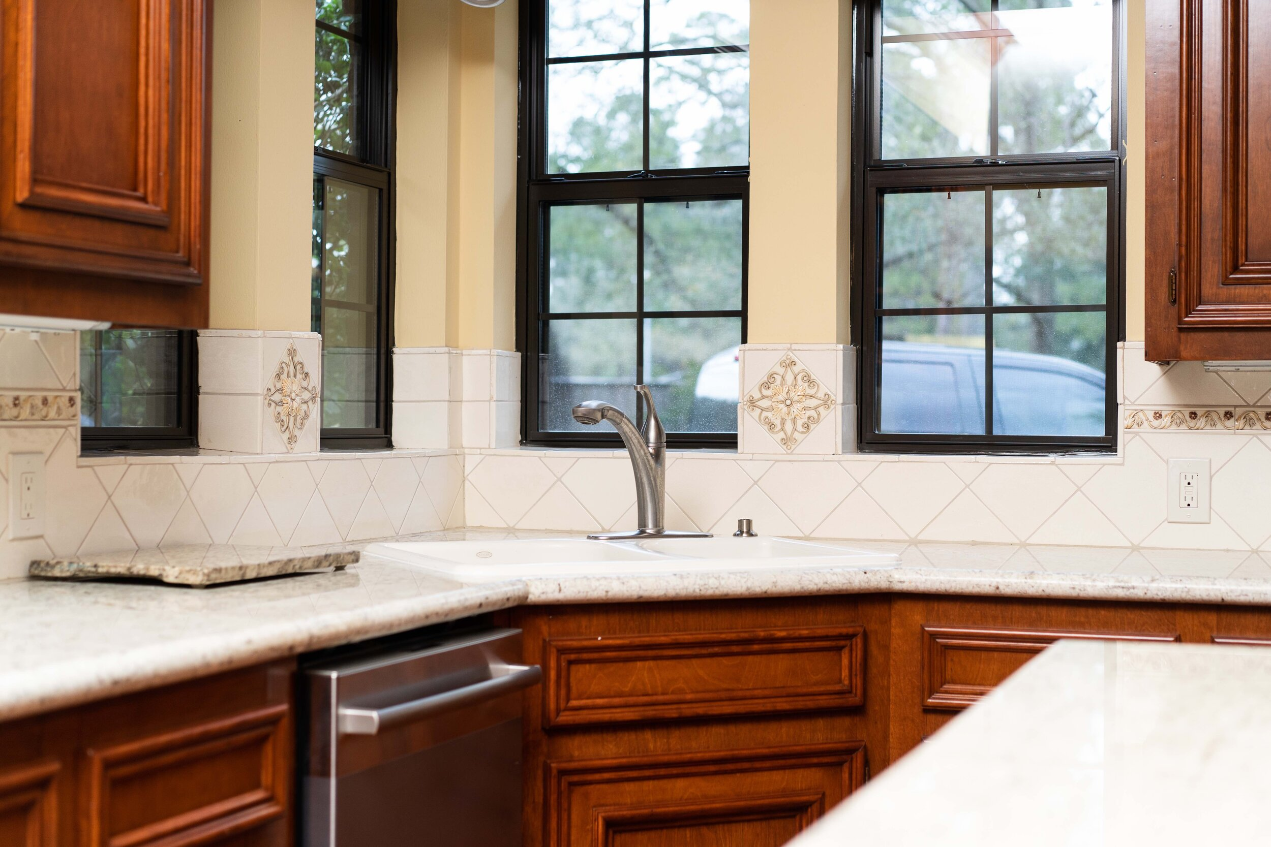 Wood stained kitchen cabinets, granite countertops, kitchen renovation, double pained windows. Kitchen renovation with stainless steel finishes.