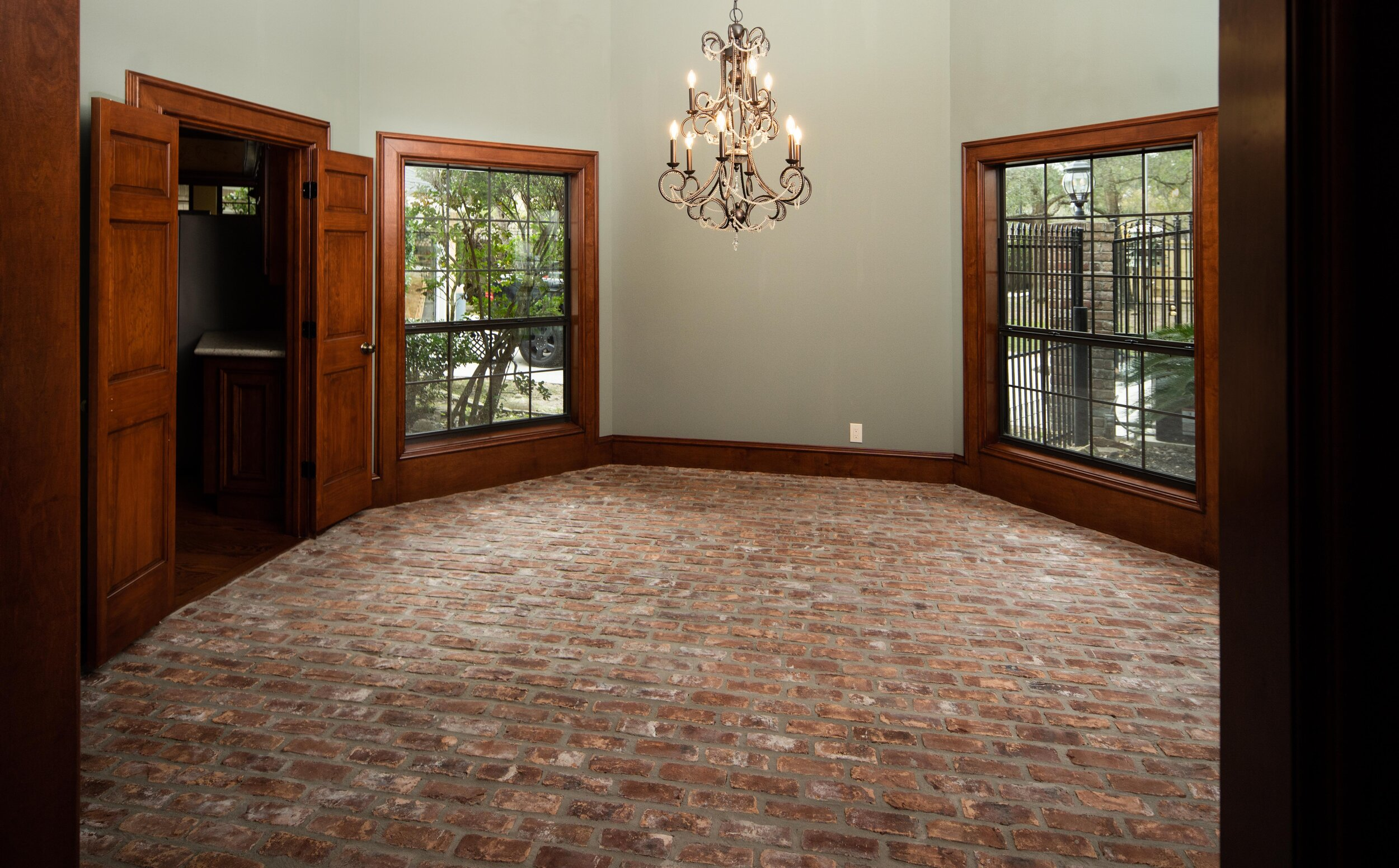 Full home restoration. Full home renovation. Wood stained trim and doors, new paint, chandelier, rustic brick floor.