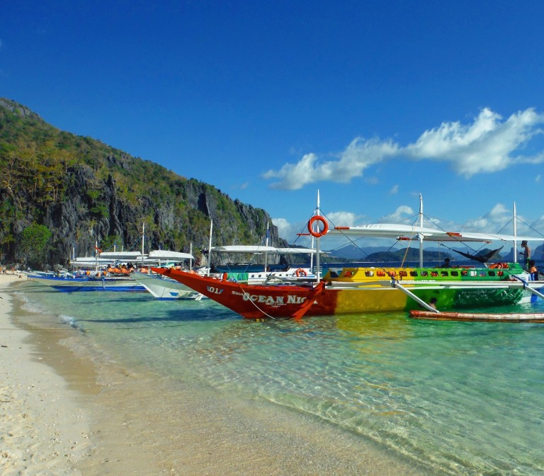 Boats moored on a beach in the Philippines
