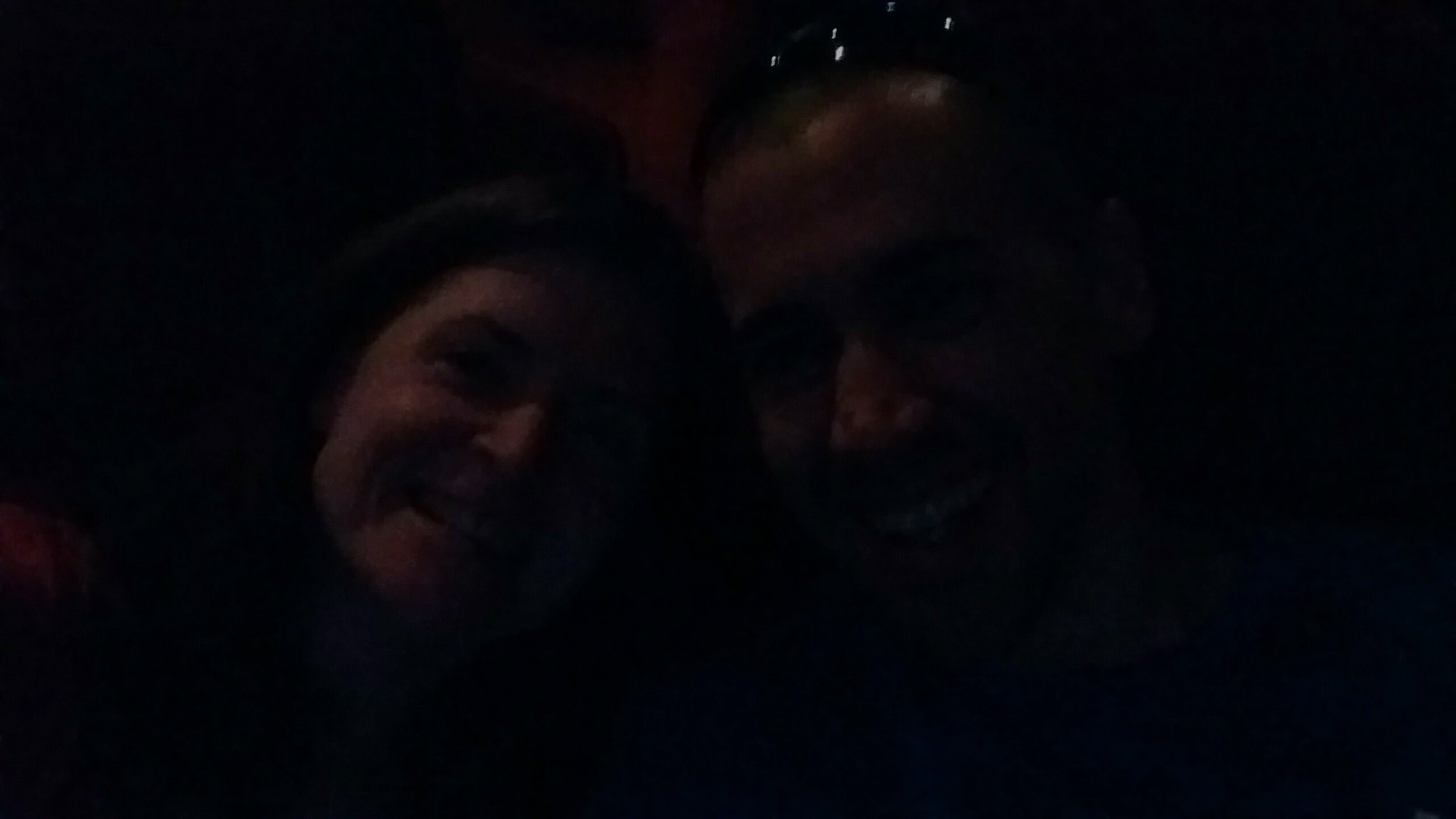 I don't know how well you can see this photo, but these are our happy faces. We managed to also have a babysitter scheduled for the night the loan funded. Here's us bursting with happiness right before the new Bourne movie starts.