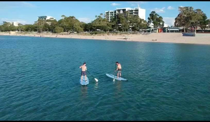 Surf Mania staff enjoying their lunch break on the Rockingham Foreshore