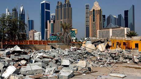 Asbestos sheeting lies among waste from the demolition of old villas and buildings in Al Satwa, Dubai. Satish Kumar / The National