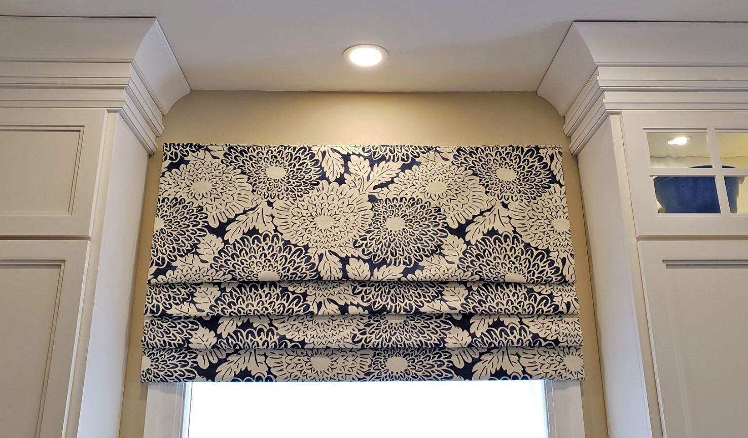 If you're not ready to commit to a boldly-patterned wallpaper, try a patterned Roman Valance!