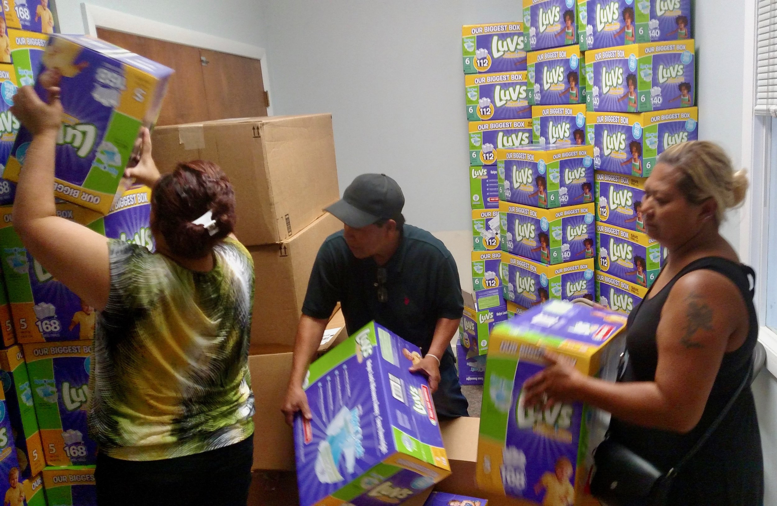 The Lowell Diaper Bank shelves, stocked with donated diapers for emergency needs.