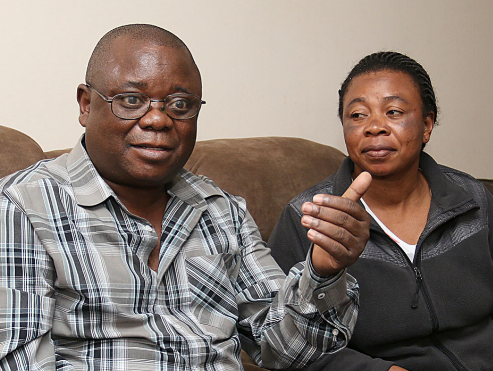 Residents Fundi Bisokah and Byose Nunda spent 19 years in refugee camps, after fleeing their home in Zaire. Now they and their 9 children may need to find new housing in Lowell.   Photo courtesy of the Lowell Sun.