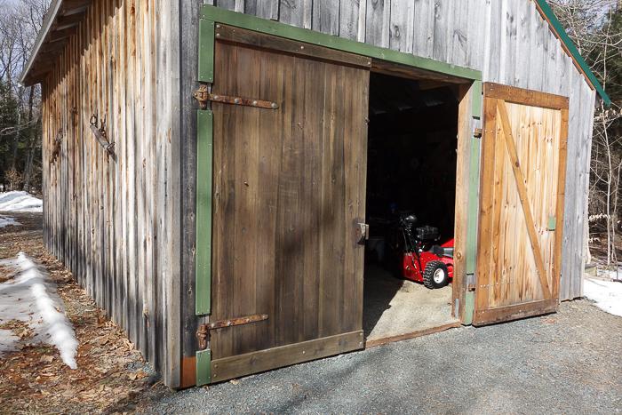 late winter barn scene with open door
