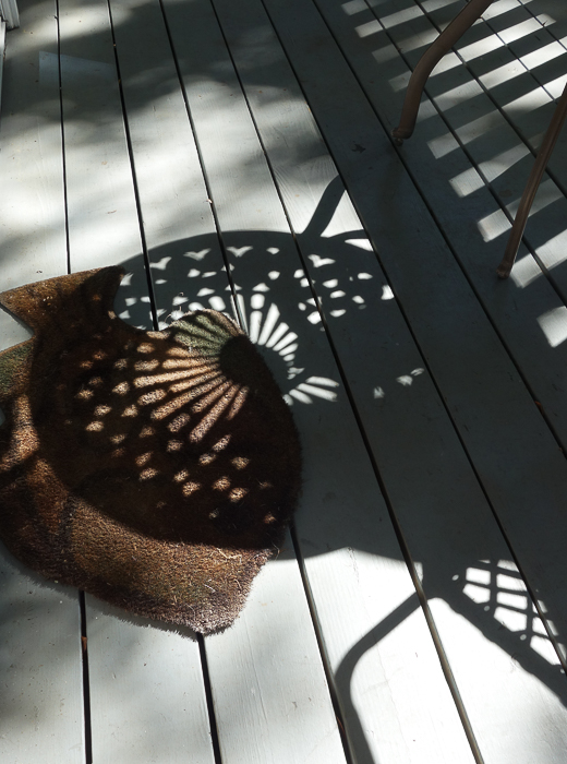 table shadow on grey deck