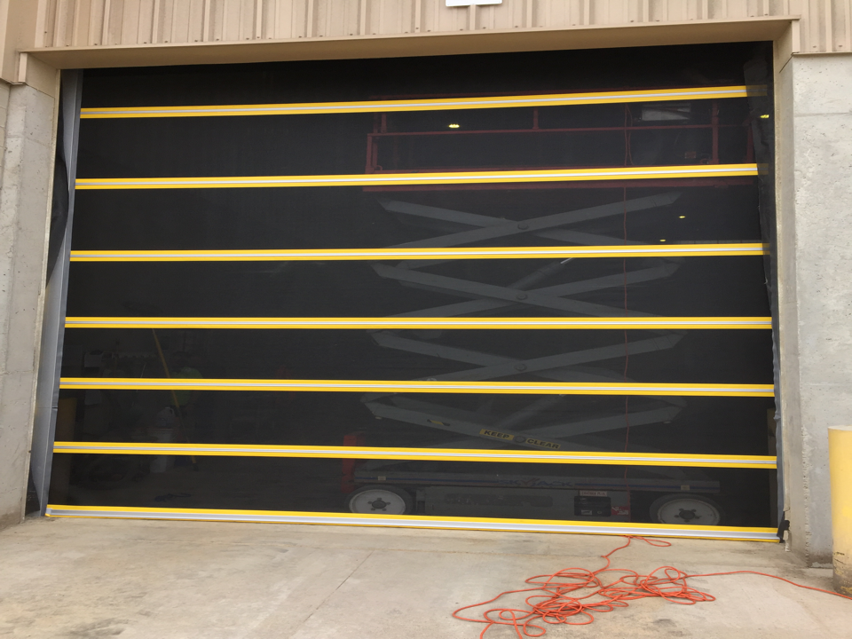 Commercial sized roll up screen doors protects against flying insects, birds, leaves and debris from entering work area, while allowing air flow into the dock. A strong choice in many applications although favored among those in the food industry.